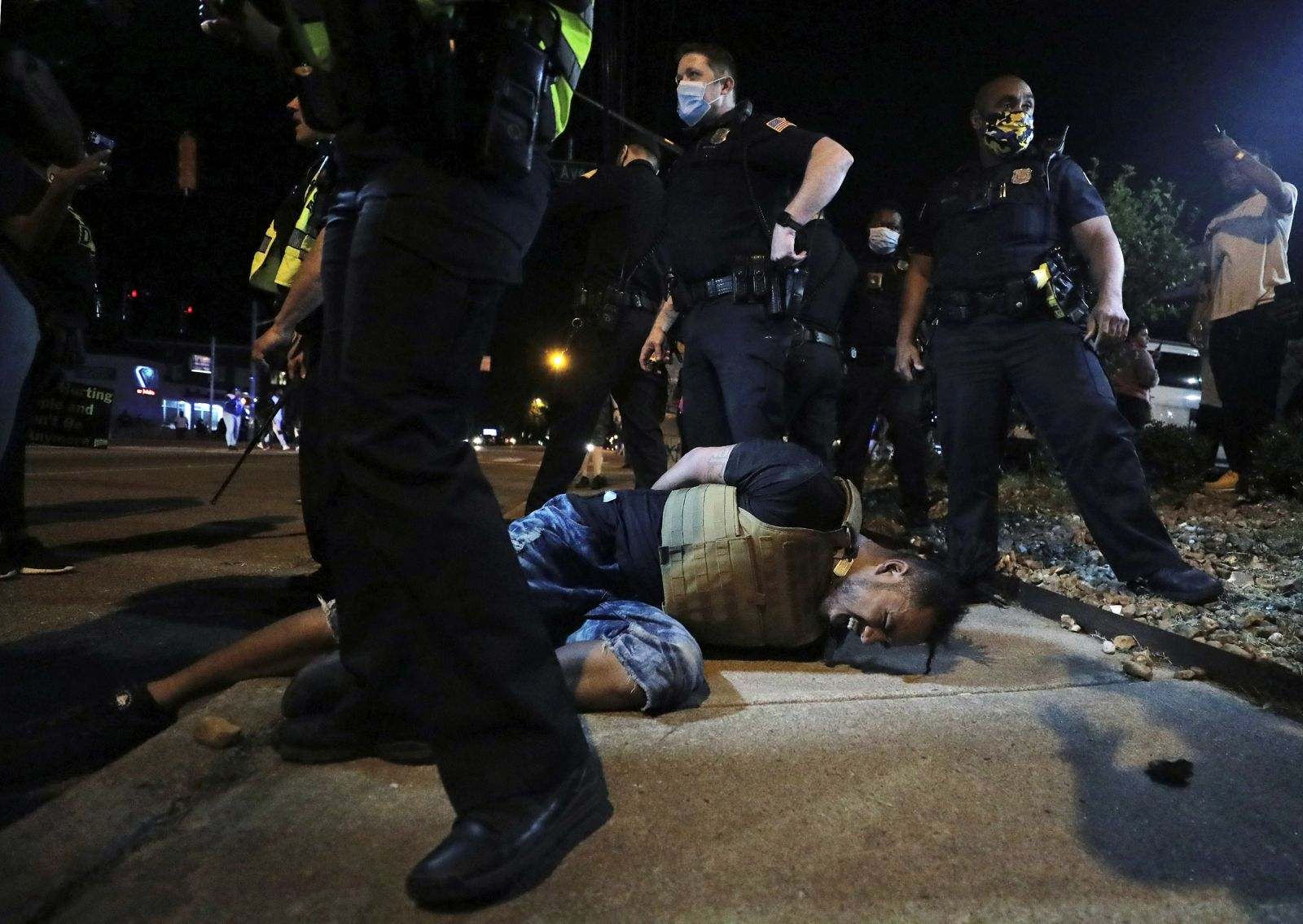 A protester winces in pain after being sprayed with pepper spray by police during a demonstration near the Memphis Police Department precinct in Memphis, Tennessee, on May 28.