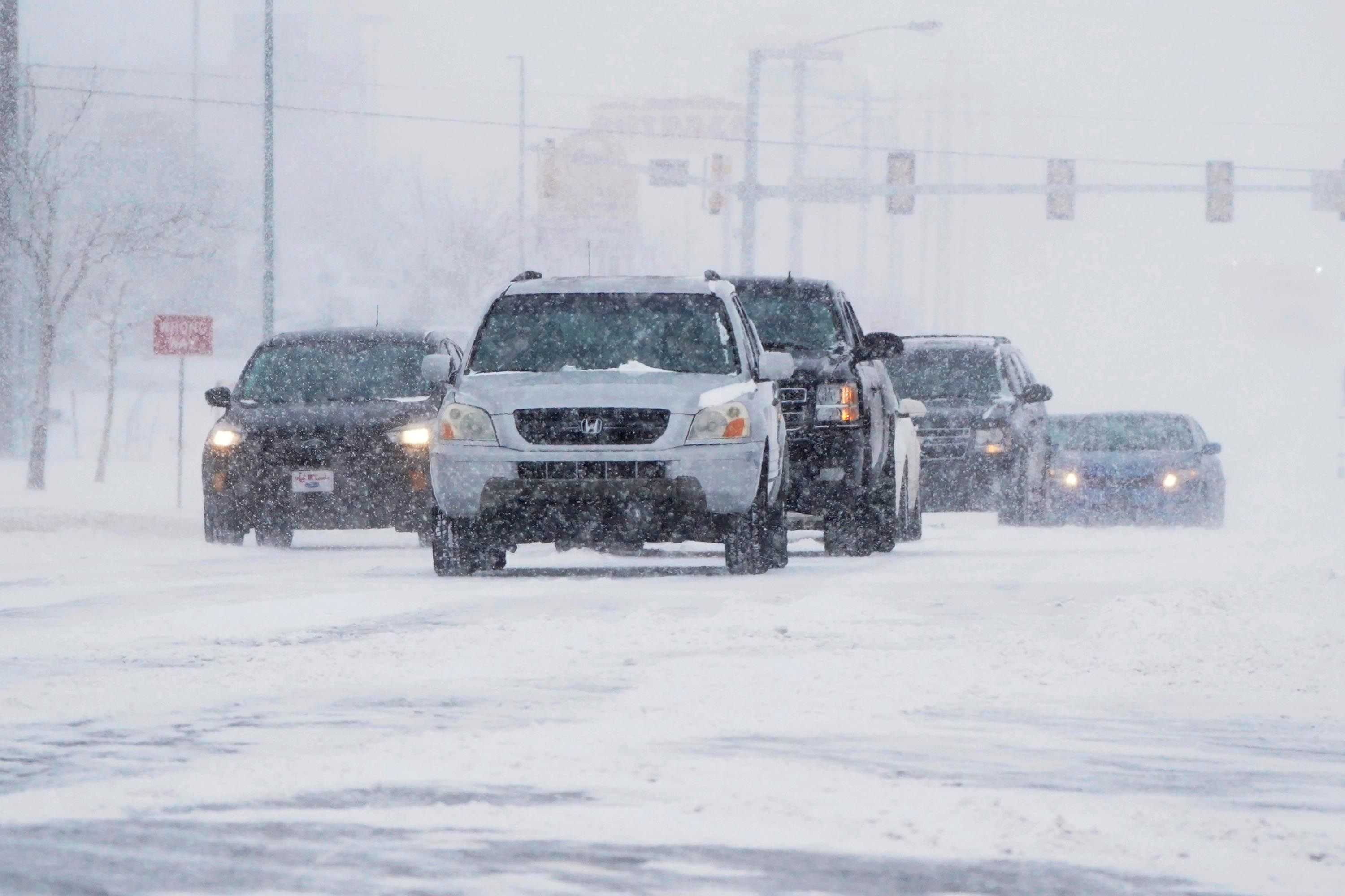 Drivers make their way along a road during a winter storm Sunday, February 14, in Oklahoma City.
