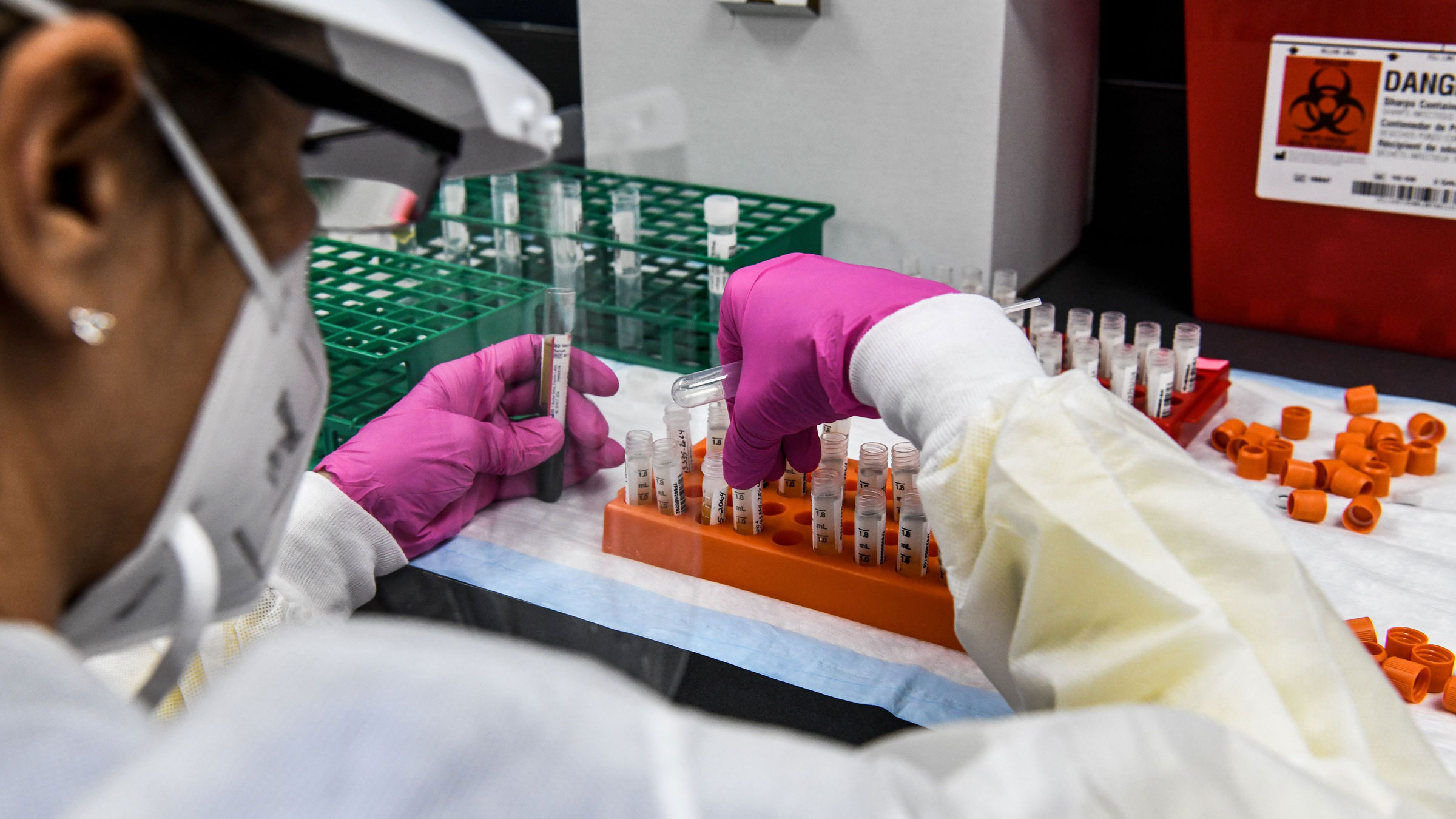 A lab technician sorts blood samples as part of a Covid-19 vaccine study in Hollywood, Florida.