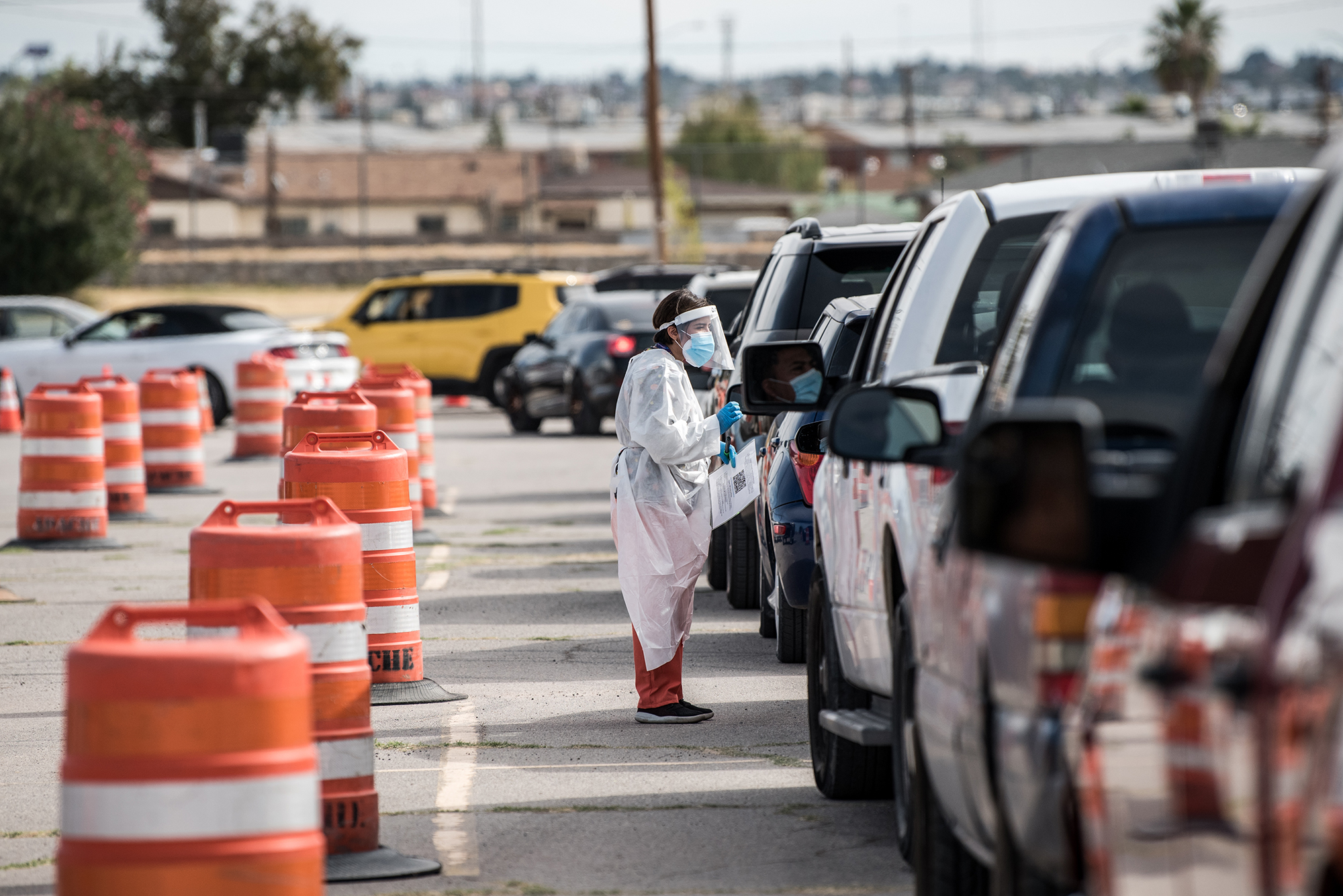 An attendant talks to a person waiting in their car at a coronavirus testing site at Ascarate Park on October 31, in El Paso, Texas.