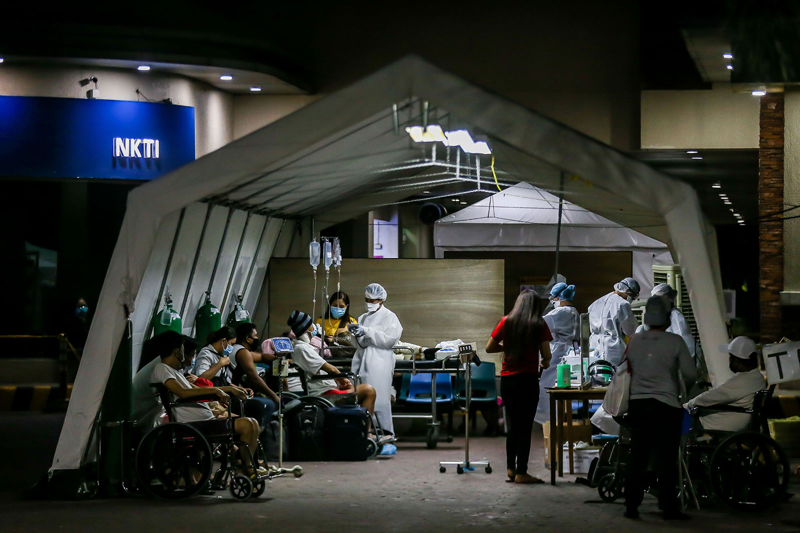 Medical workers screen patients for coronavirus outside of a hospital in Quezon City, Philippines, on March 28.