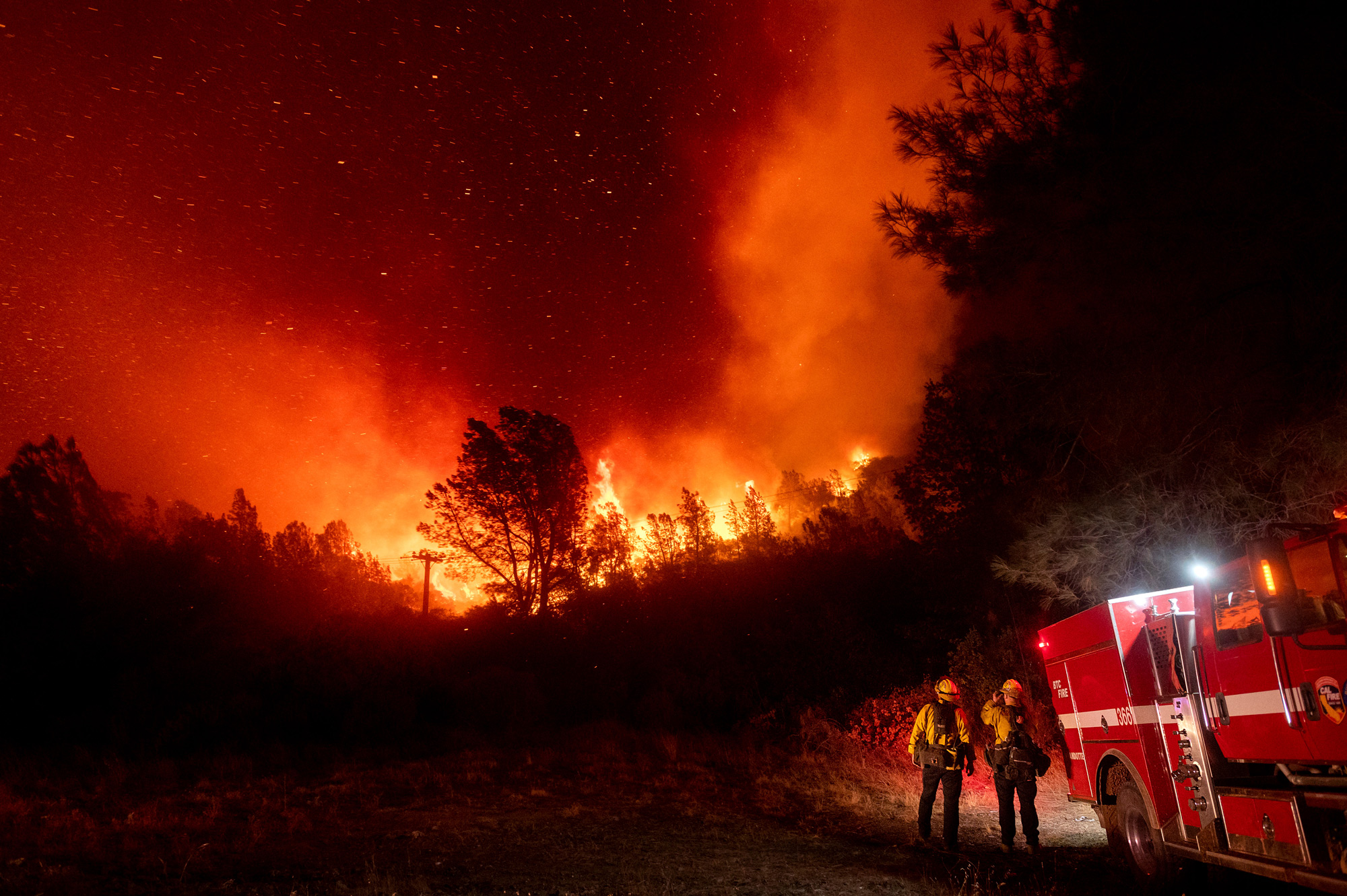 Firefighters watch the Bear Fire approach in Oroville, California, on September 9.