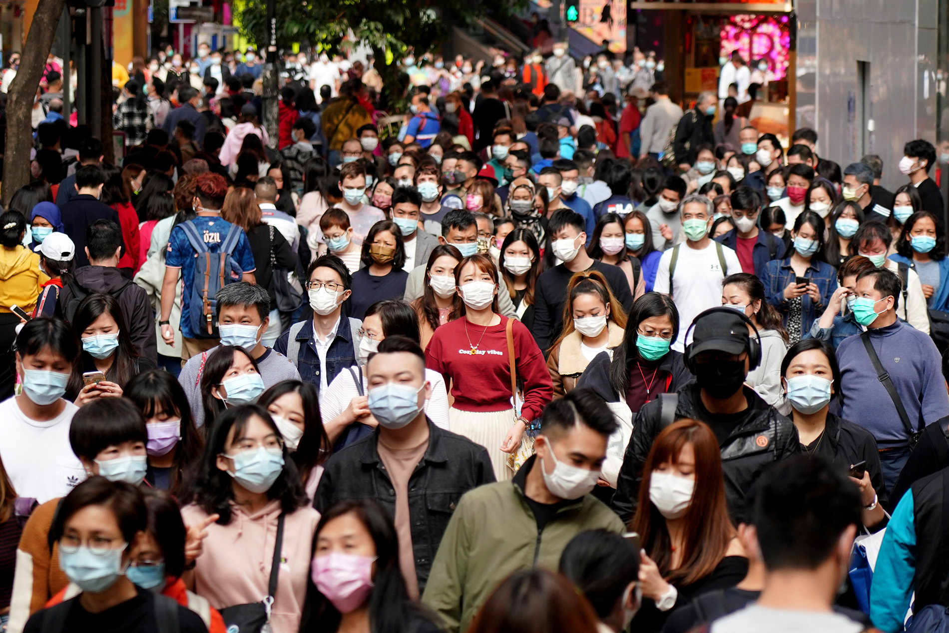 People wearing masks visit Causeway Bay on the third day of the Chinese New Year, on February 14, 2021, in Hong Kong.