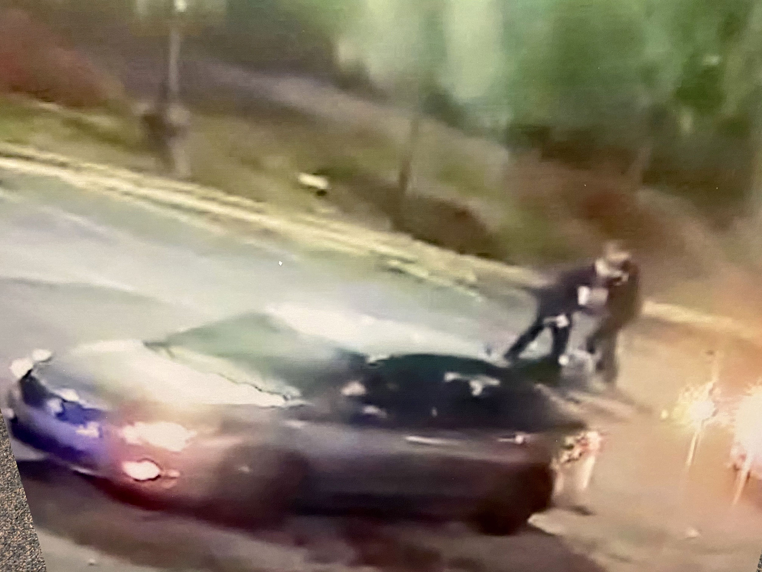 This image, presented by the office of the Fulton County District Attorney, shows Officer Devin Brosnan standing on Rayshard Brooks. Brosnan faces an aggravated assault charge.