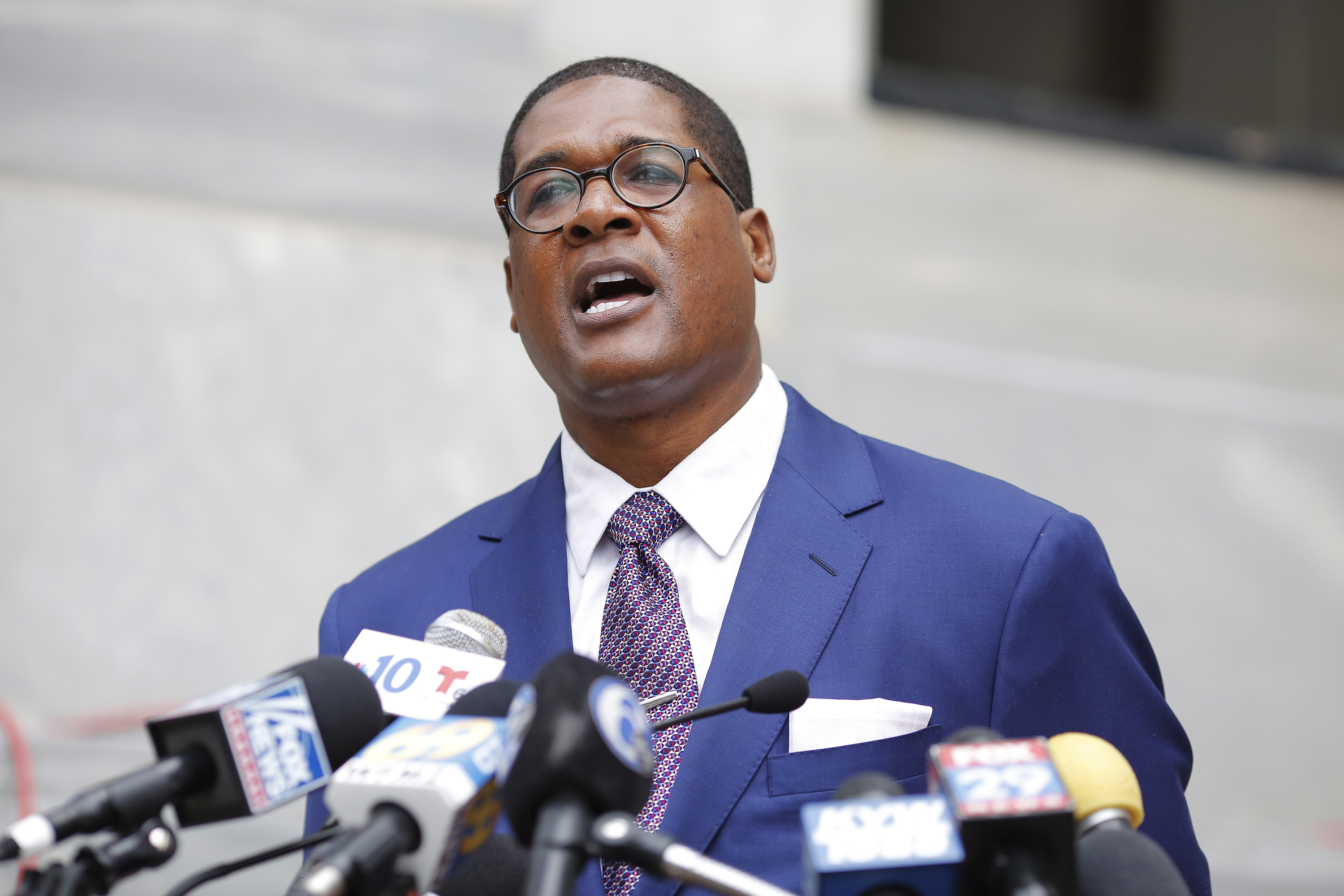 Andrew Wyatt, spokesman for Bill Cosby, speaks to the media after the defense's closing argument in the retrial of Cosby's sexual assault case on April 24, 2018.