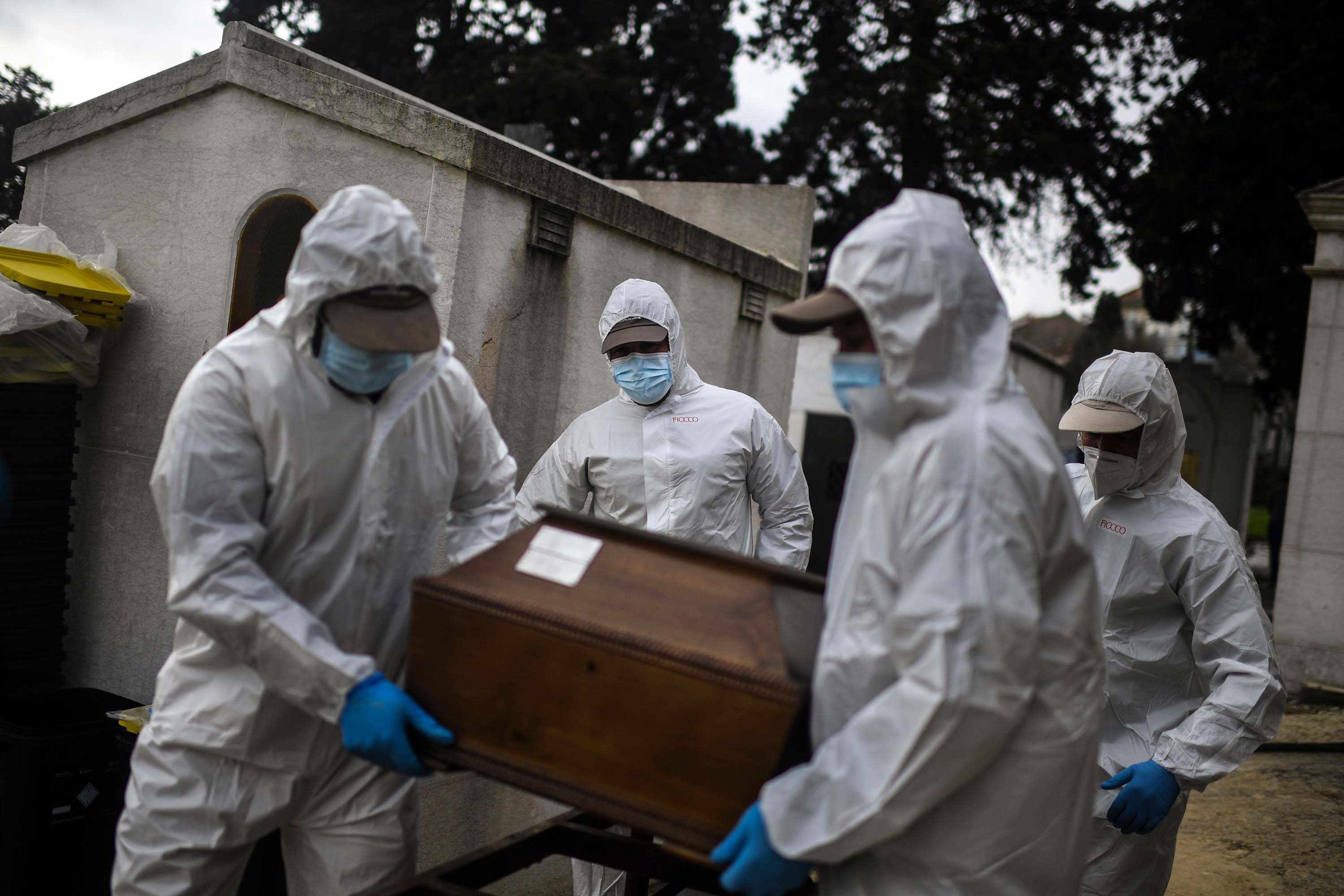 Grave diggers carry the coffin of a Covid-19 victim at the Alto de Sao Joao cemetery in Lisbon, Portugal, on February 18.