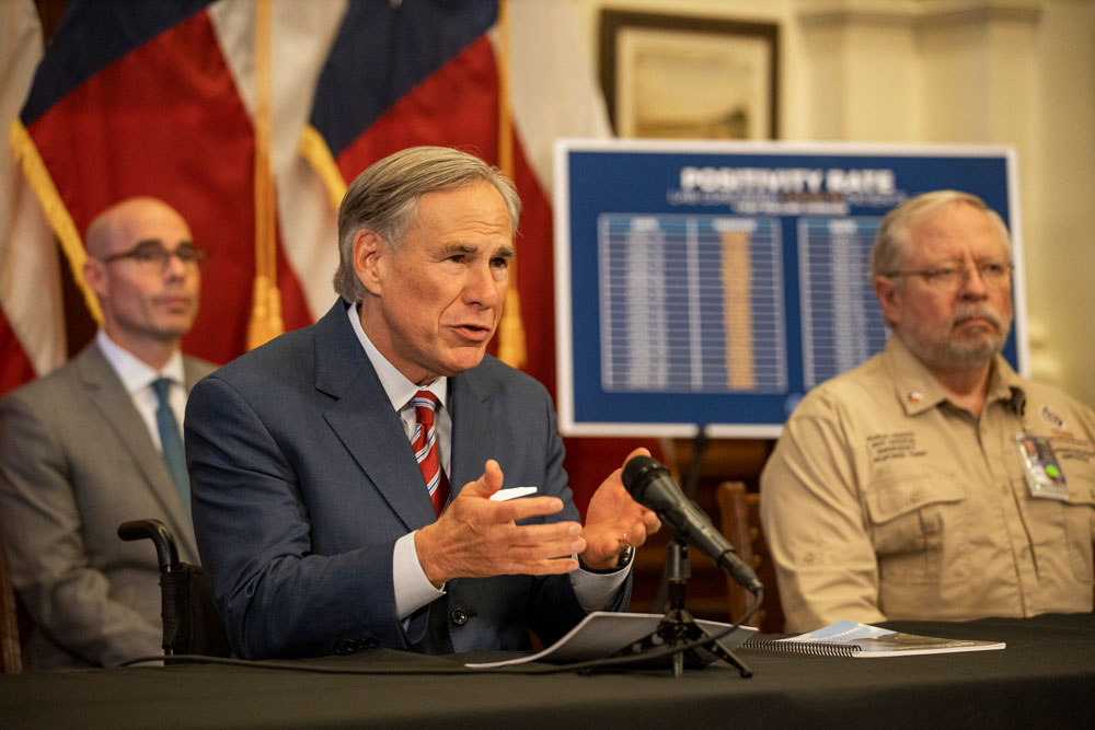 Texas Gov. Greg Abbott announces the reopening of more Texas businesses at a press conference at the Texas State Capitol in Austin on Monday, May 18.