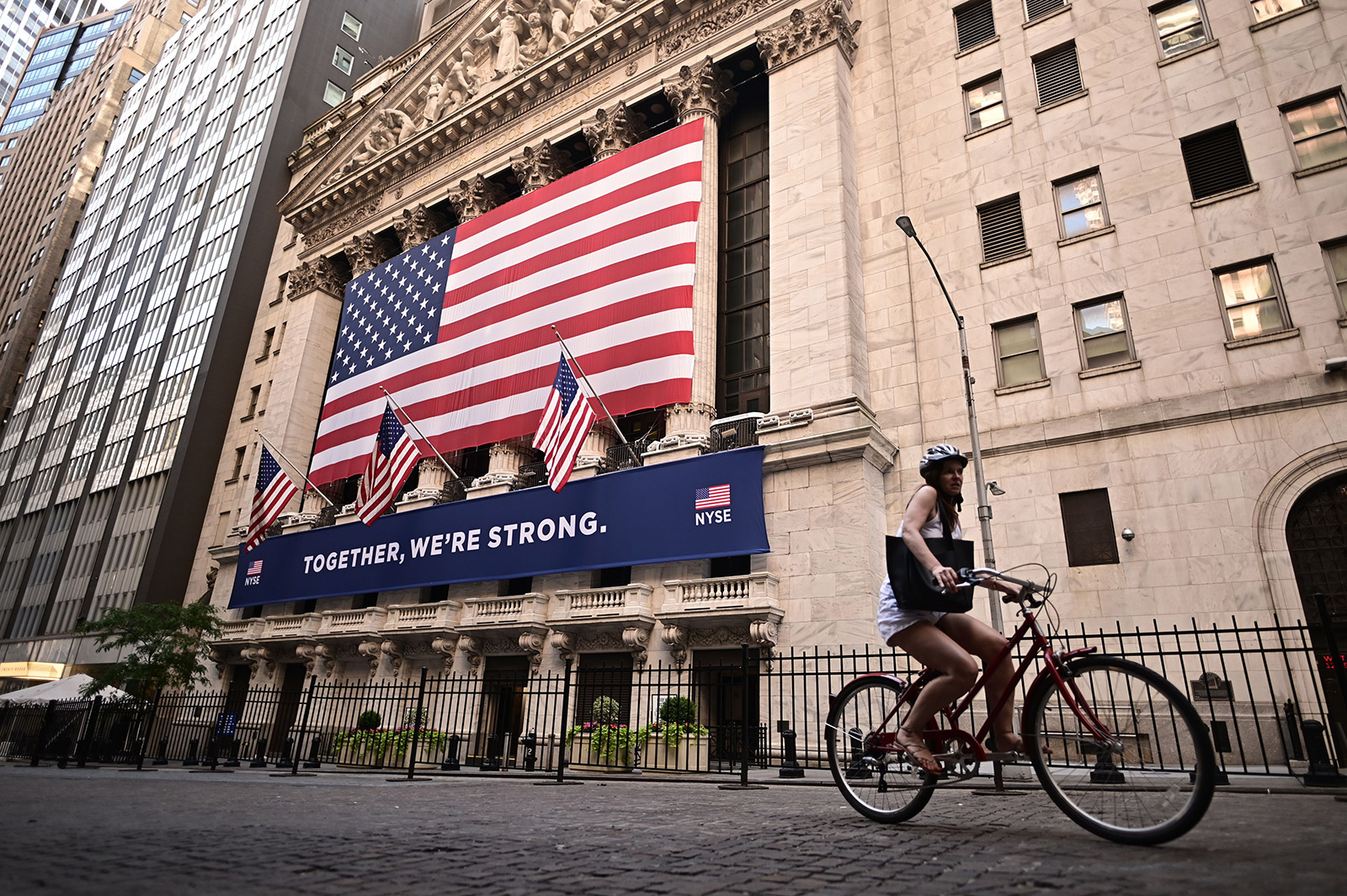 A woman passes the New York Stock Exchange on Monday.
