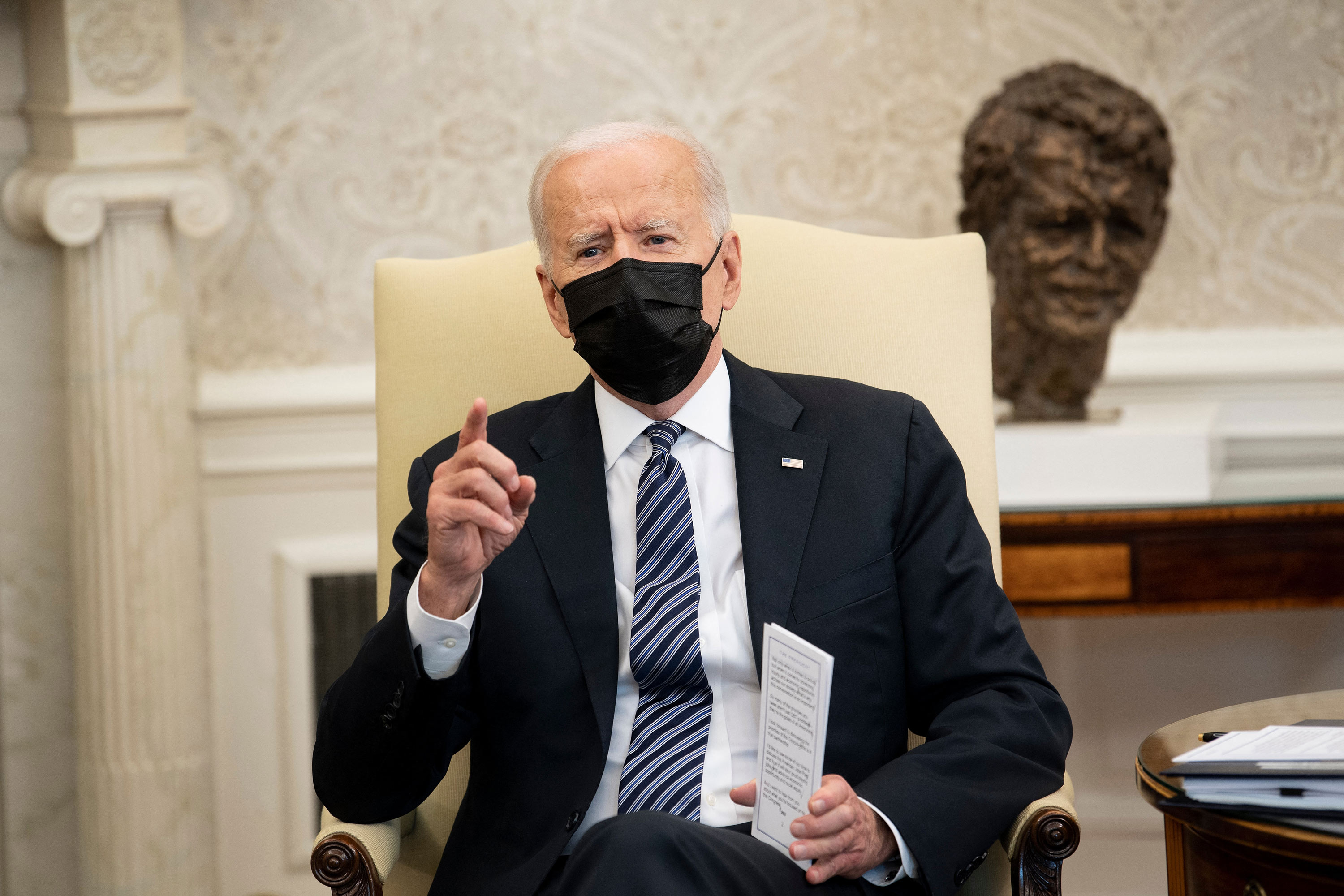 President Joe Biden speaks before a meeting in the Oval Office of the White House on April 13 in Washington, DC.