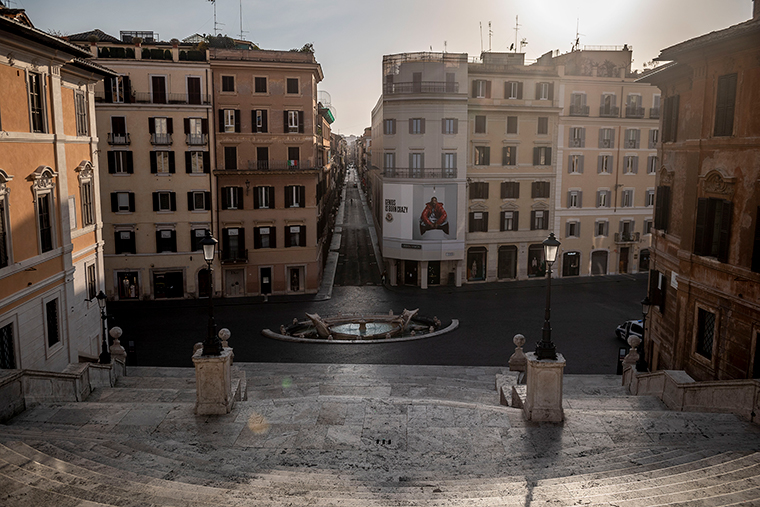 A general view of Spanish Square area and Via dei Condotti empty of tourists on Monday, March 30, in Rome.