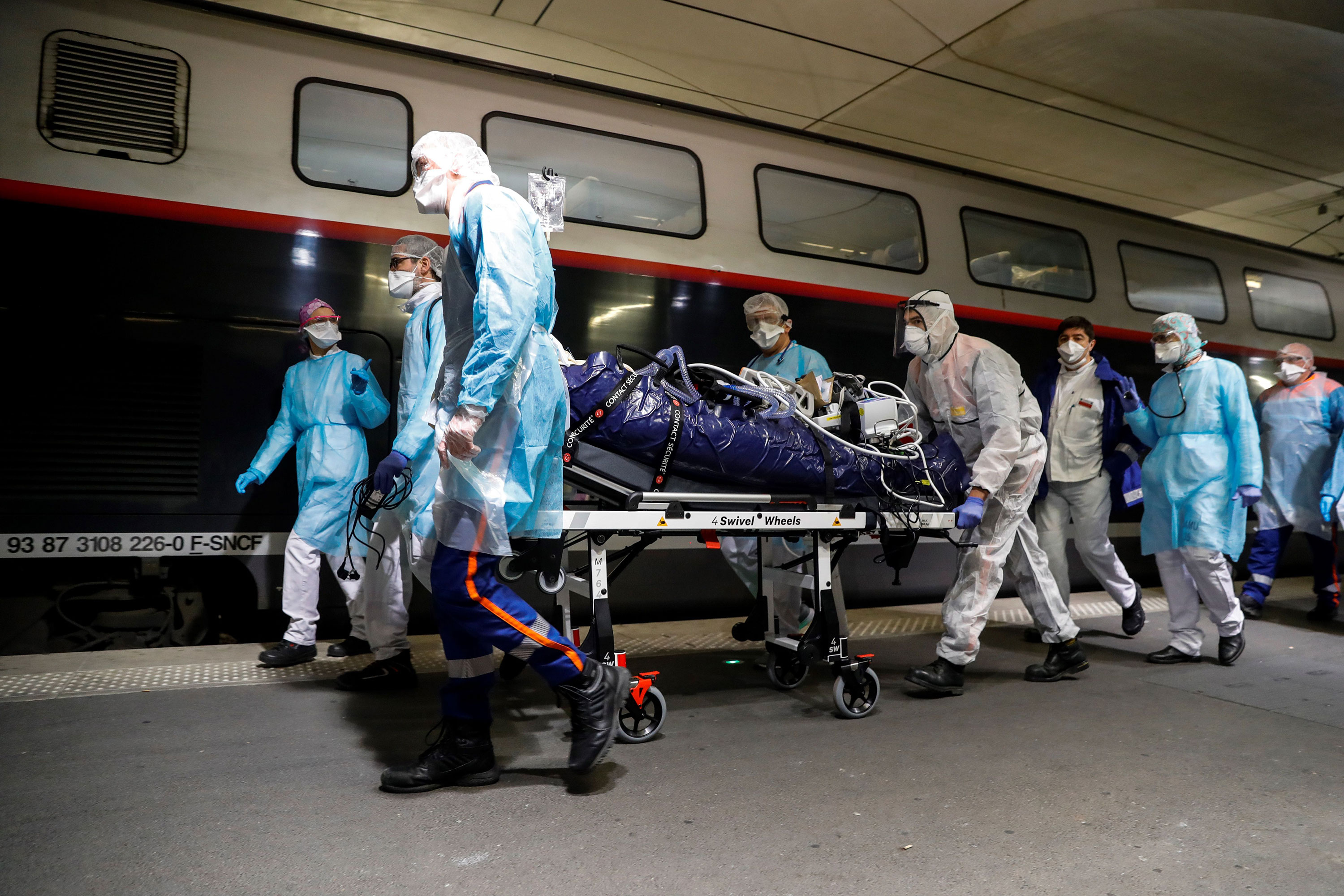 Medical staff wheel a patient to a high speed train at the Gare d'Austerlitz train station in Paris on April 1 to be evacuated to other hospitals in western France.