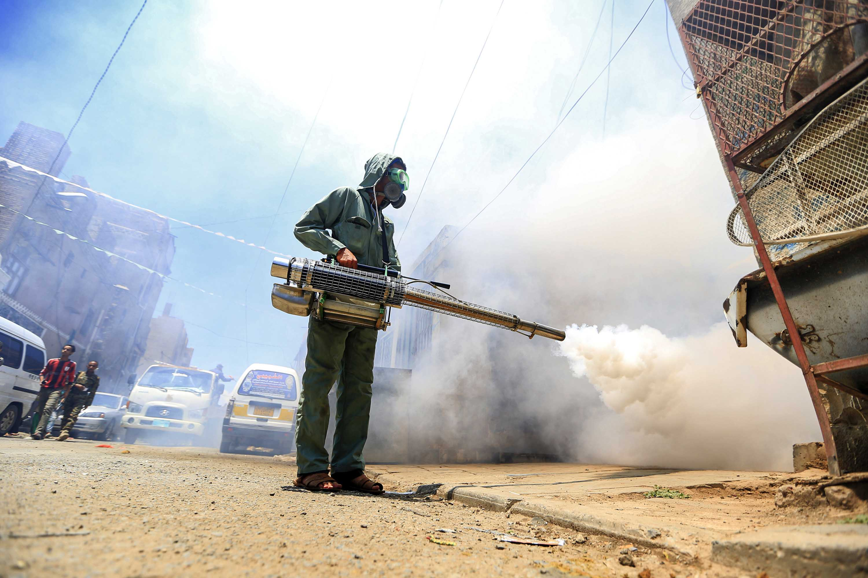 A local administration worker fumigates a neighbourhood in Yemen's capital, Sanaa, on March 23.