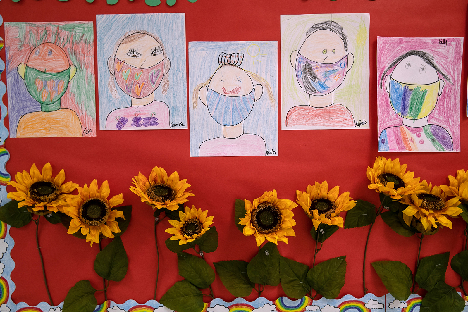 Drawings of children wearing masks adorn a hallway at Stark Elementary School on September 16, in Stamford, Connecticut.