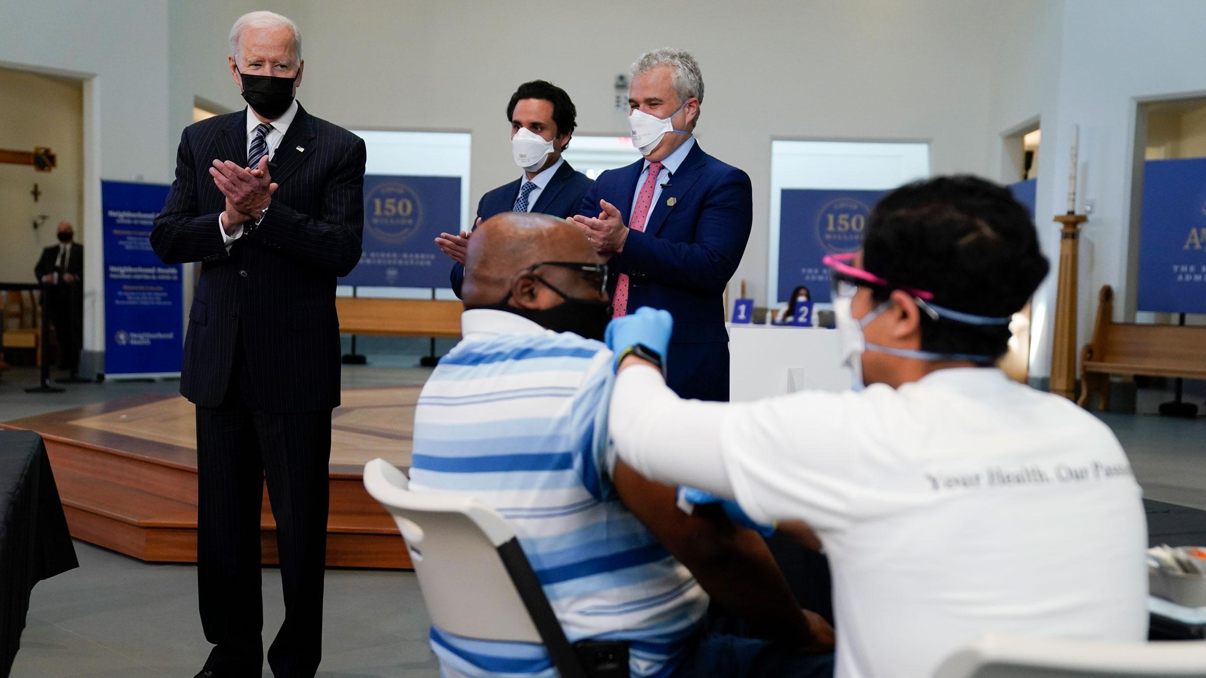 President Joe Biden visits a vaccination site in Alexandria, Virginia, on Tuesday.