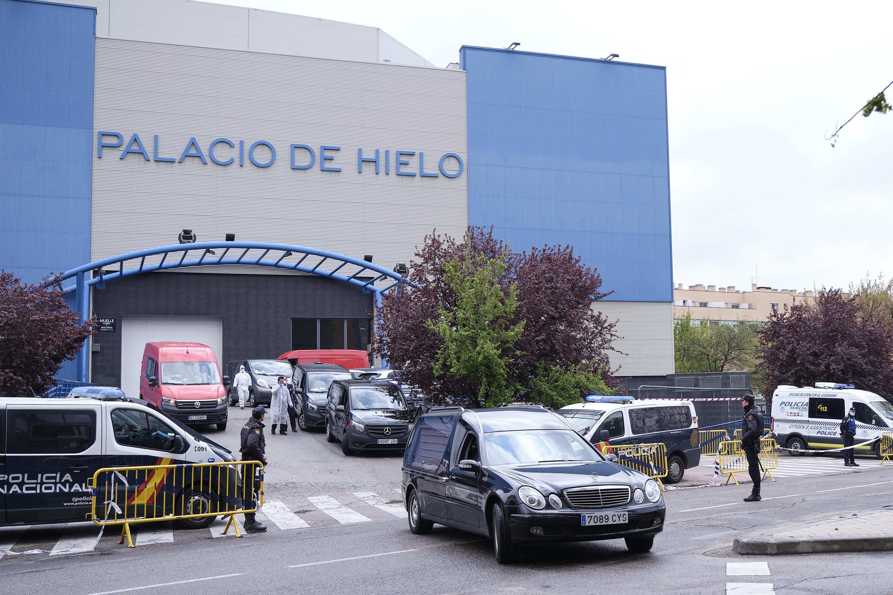 Funeral cars and vans wait outside the Palacio de Hielo in Madrid, Spain, on March 27, where coronavirus victims' bodies are kept at an ice rink temporarily converted into a morgue.