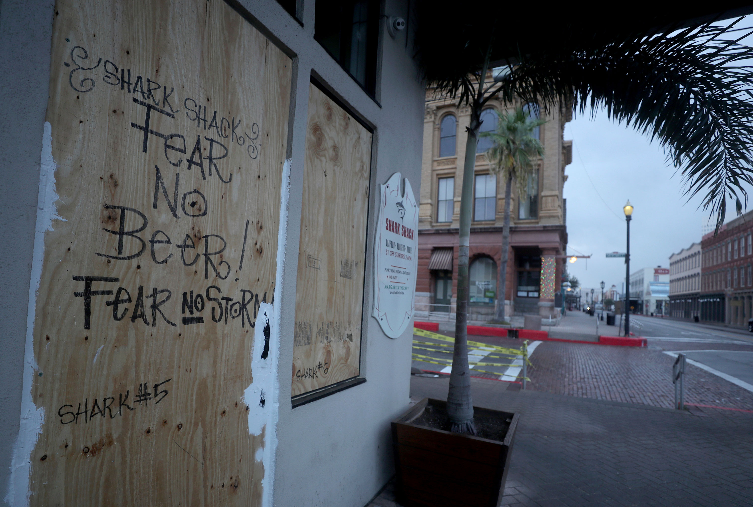 The Shark Shack Beach Bar and Grill is boarded up on the nearly deserted Strand Street in Galveston, Texas, on Wednesday, August 26.