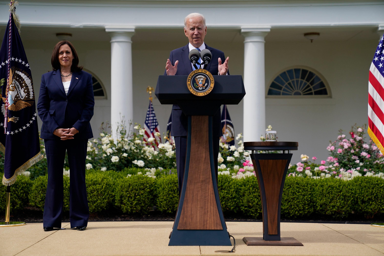 Vice President Kamala Harris listens as President Joe Biden speaks in the Rose Garden of the White House on May 13 in Washington, DC.