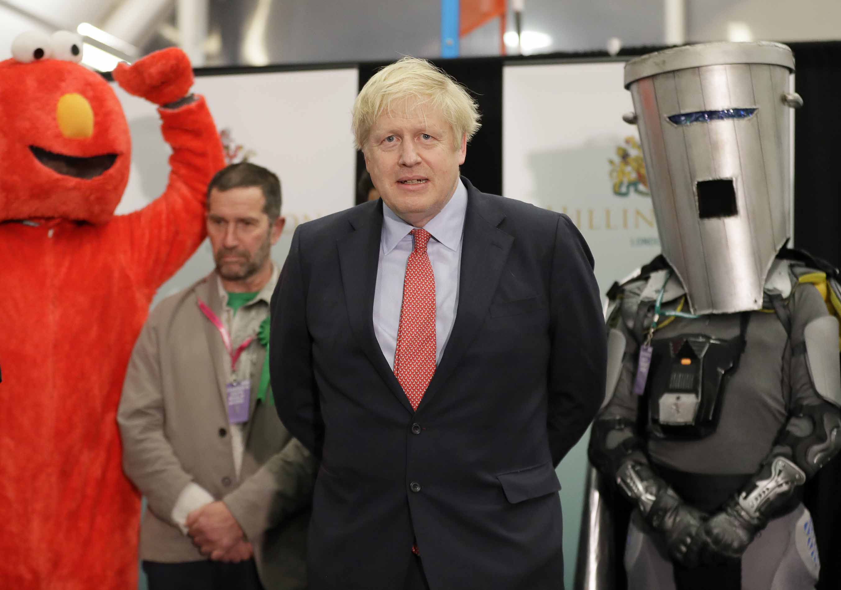 Prime Minister Boris Johnson is joined on stage by Bobby Smith, leader of the 'Give Me Back Elmo' party, and Independent candidate Count Binface during the count declaration at Brunel University in Uxbridge, London. Photo: Kirsty Wigglesworth/AP