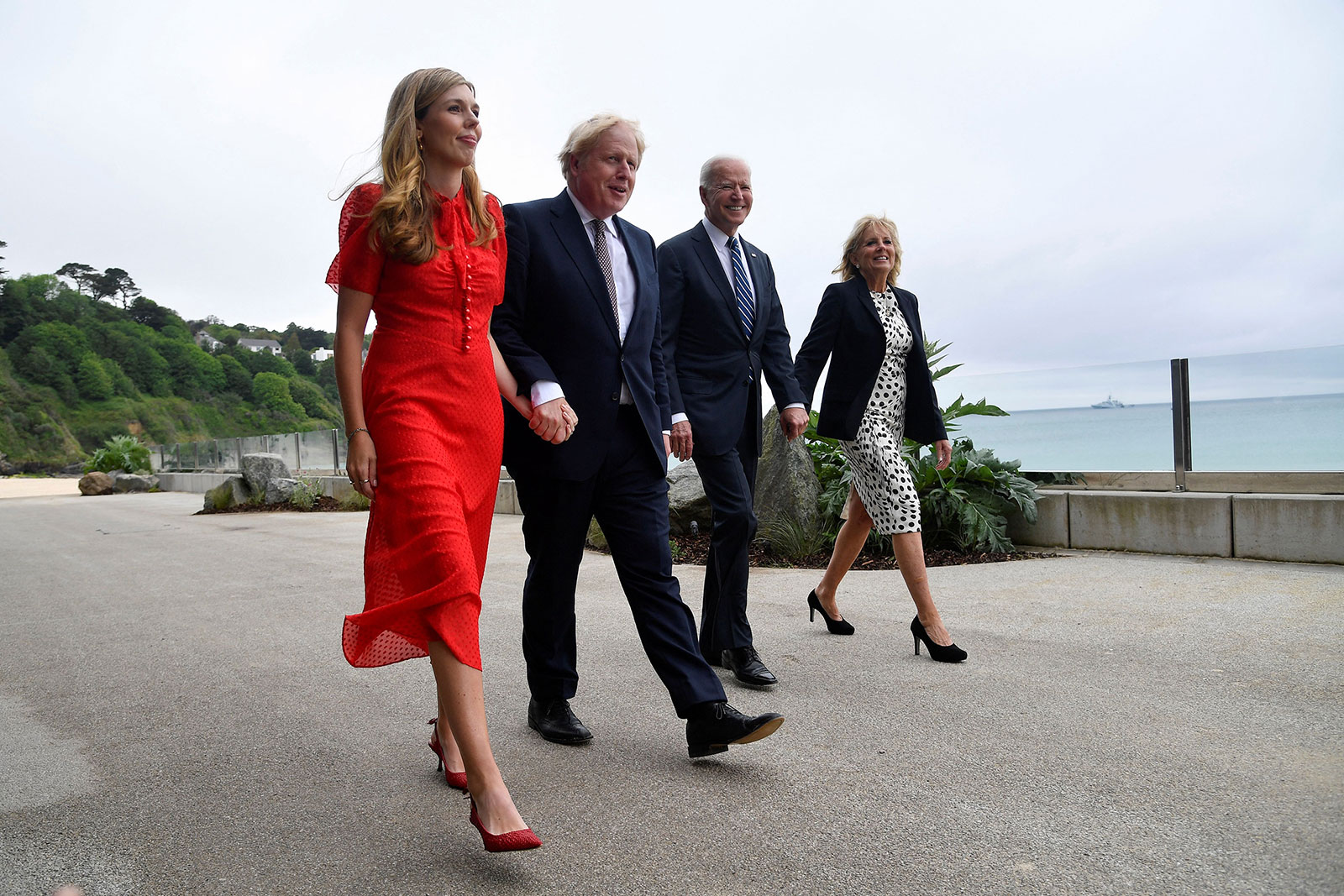Britain's Prime Minister Boris Johnson, his wife Carrie Johnson and US President Joe Biden with first lady Jill Biden walk outside Carbis Bay, Cornwall, on Thursday, June 10.