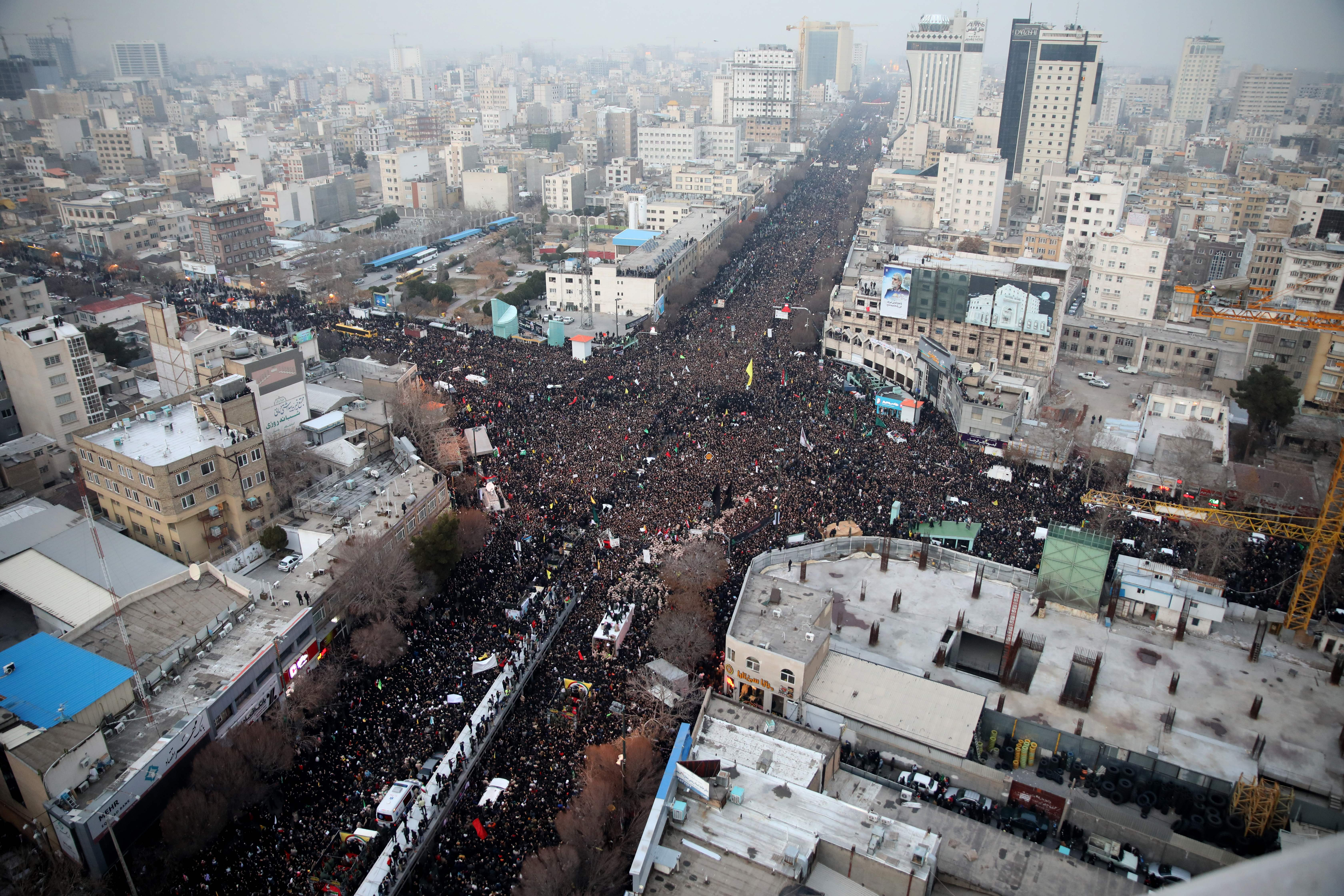 Iranians march behind a vehicle carrying the coffins of slain major general Qasem Soleimani and others as they pay homage in the northeastern city of Mashhad on Jan. 5.
