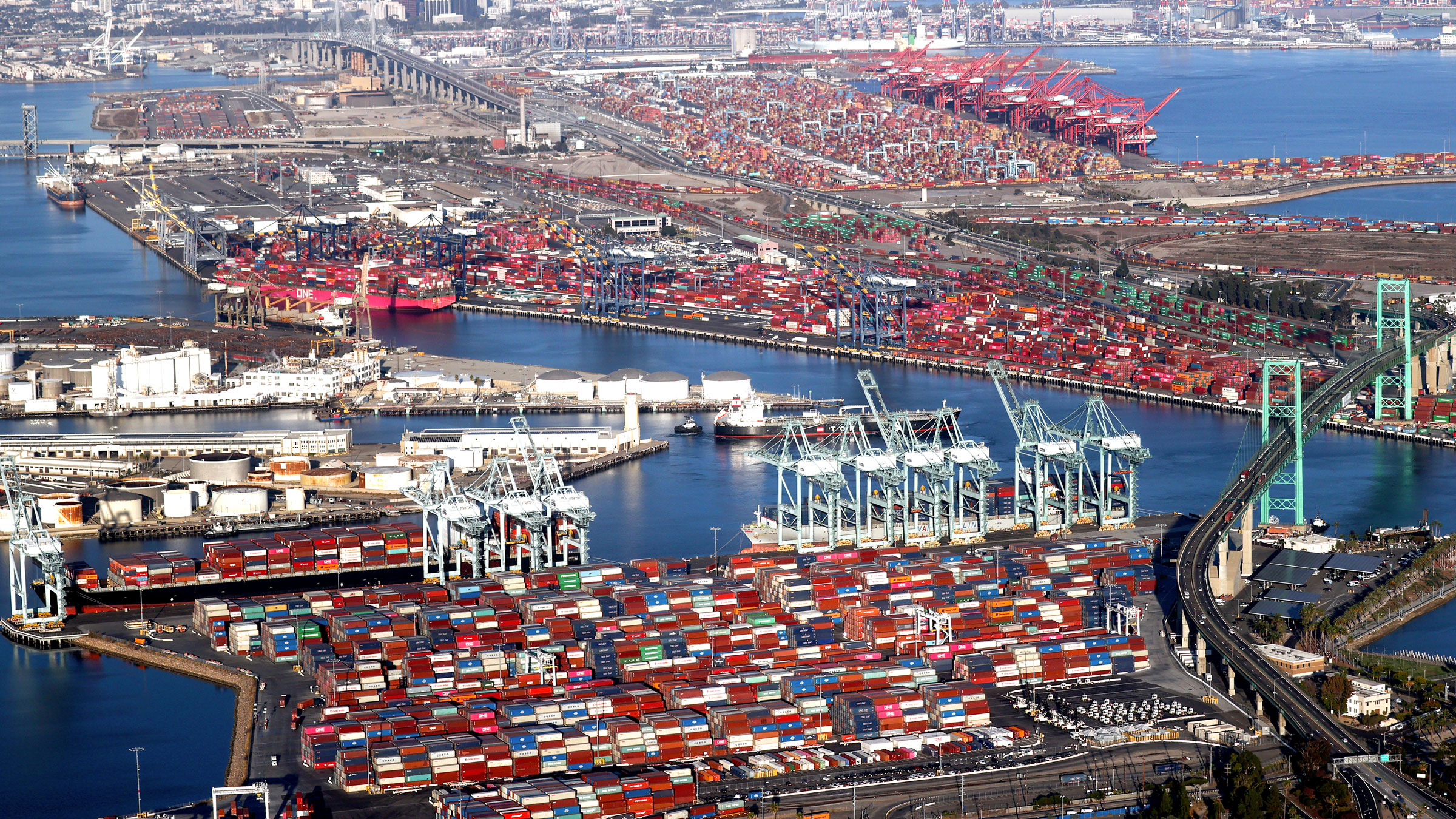 Shipping containers and container ships are seen at the ports of Long Beach and Los Angeles on September 20.