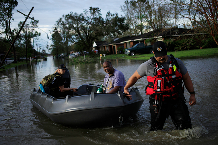 First responders rescue a resident from floodwater left behind by Hurricane Ida in LaPlace, Louisiana, on Monday, August 30.