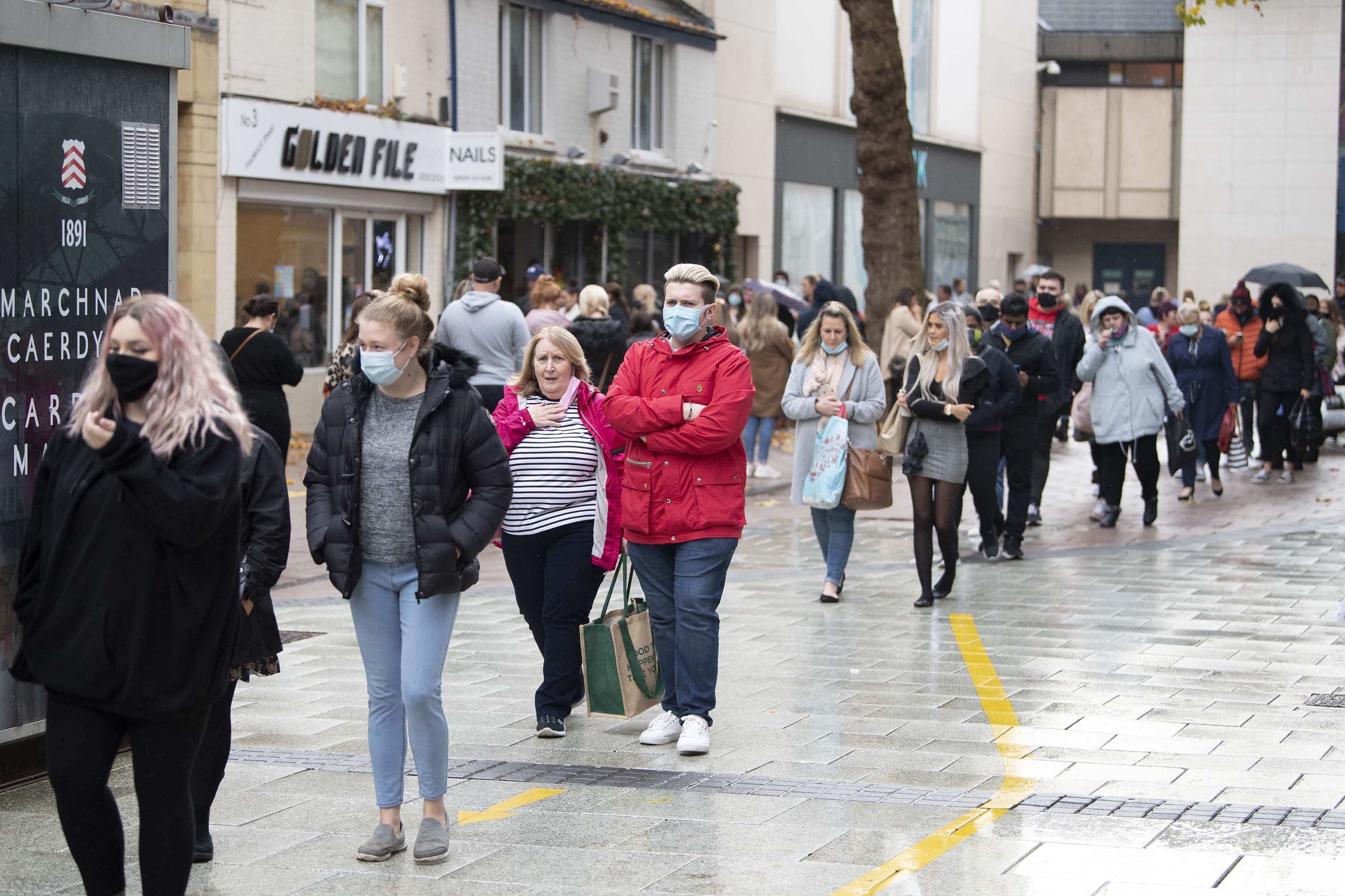Shoppers line up outside a store in Cardiff, Wales, on November 9.