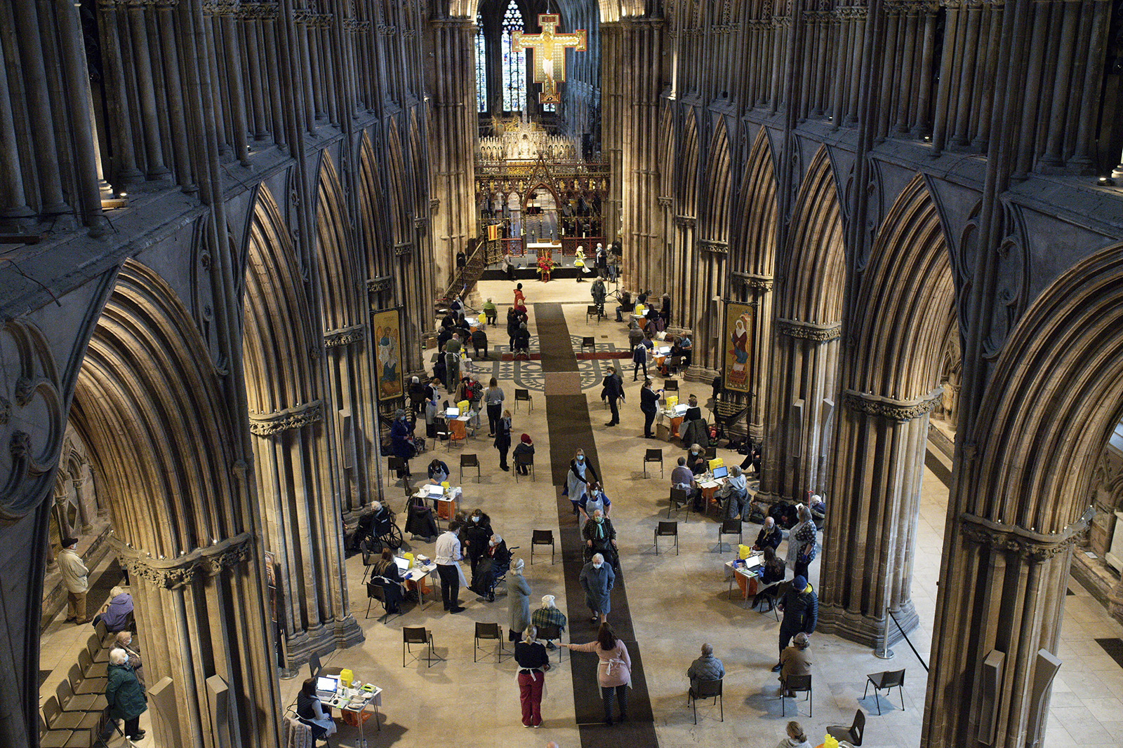 Members of the public receive the Oxford/AstraZeneca coronavirus vaccine at Lichfield Cathedral, in Staffordshire, England, on Friday, January 15.
