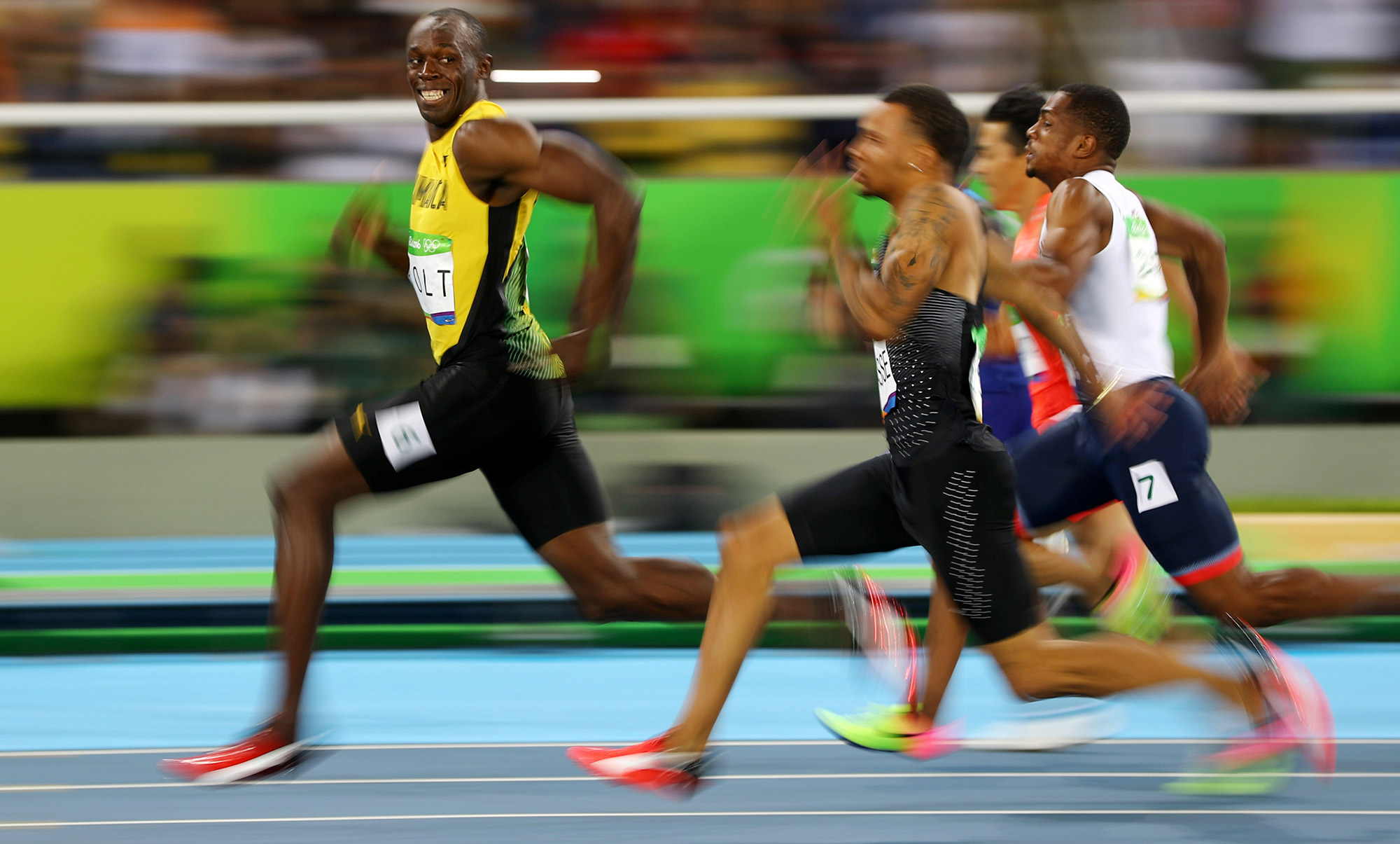 Jamaican sprinter Usain Bolt looks back at his Olympic competitors during a 100-meter semifinal in 2016.
