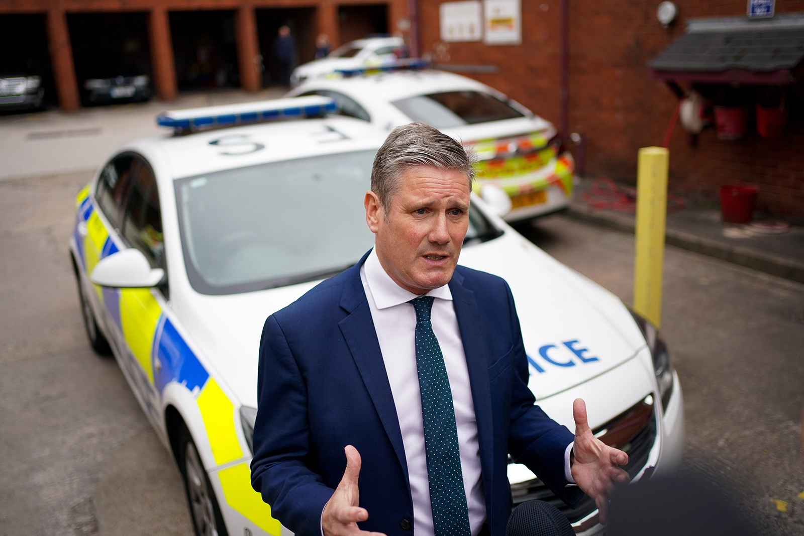 Labour leader Sir Keir Starmer talks to police officers outside Wolverhampton Police Station during a visit to Wolverhampton on Monday.