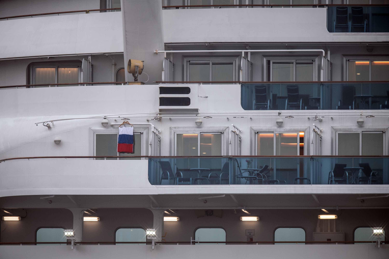 A Russian flag is hung from a balcony onboard the quarantined Diamond Princess cruise ship in Yokohama, Japan on Sunday.
