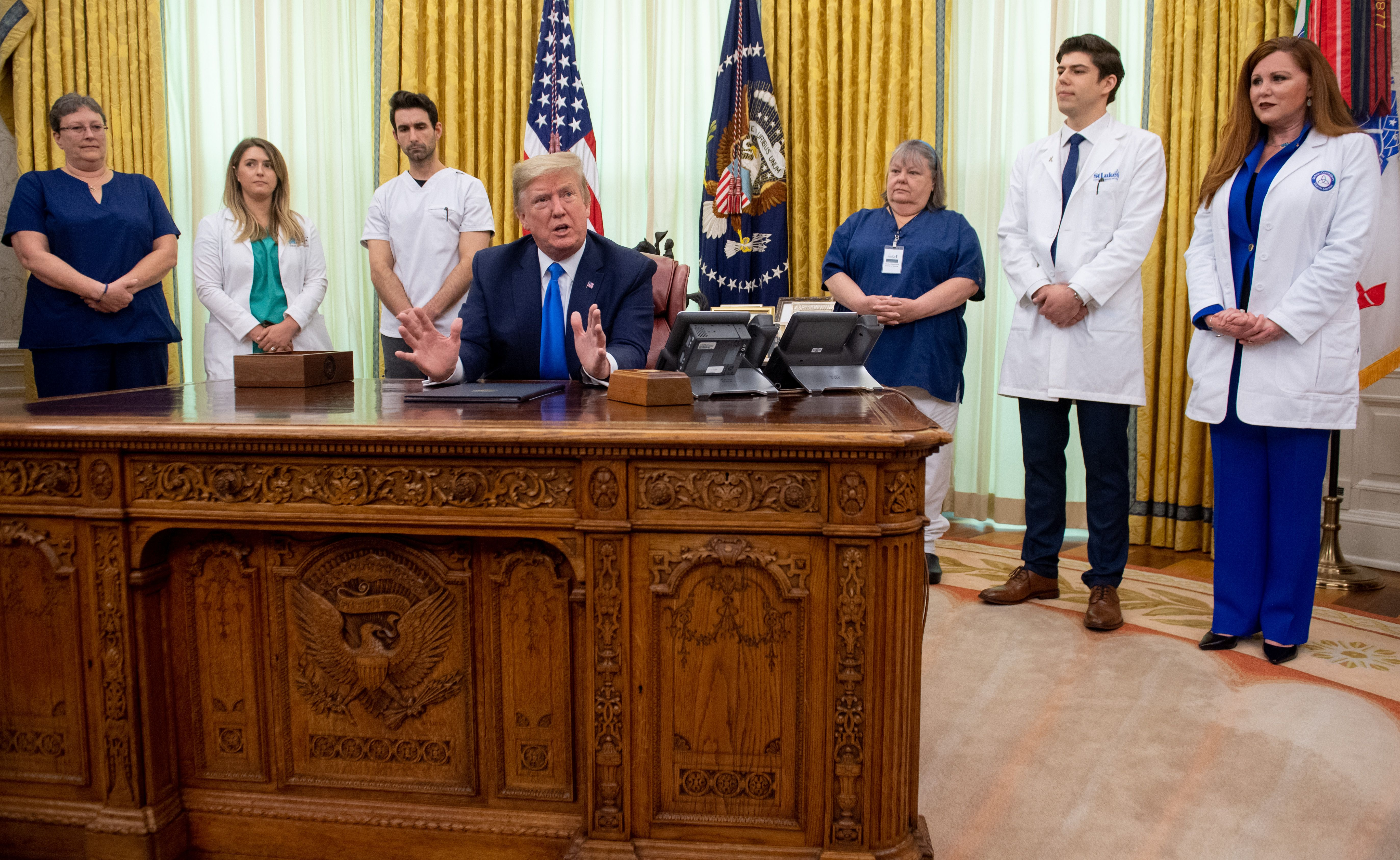 President Donald Trump, flanked by nurses, speaks at the White House on May 6 after signing a proclamation in honor of National Nurses Day.