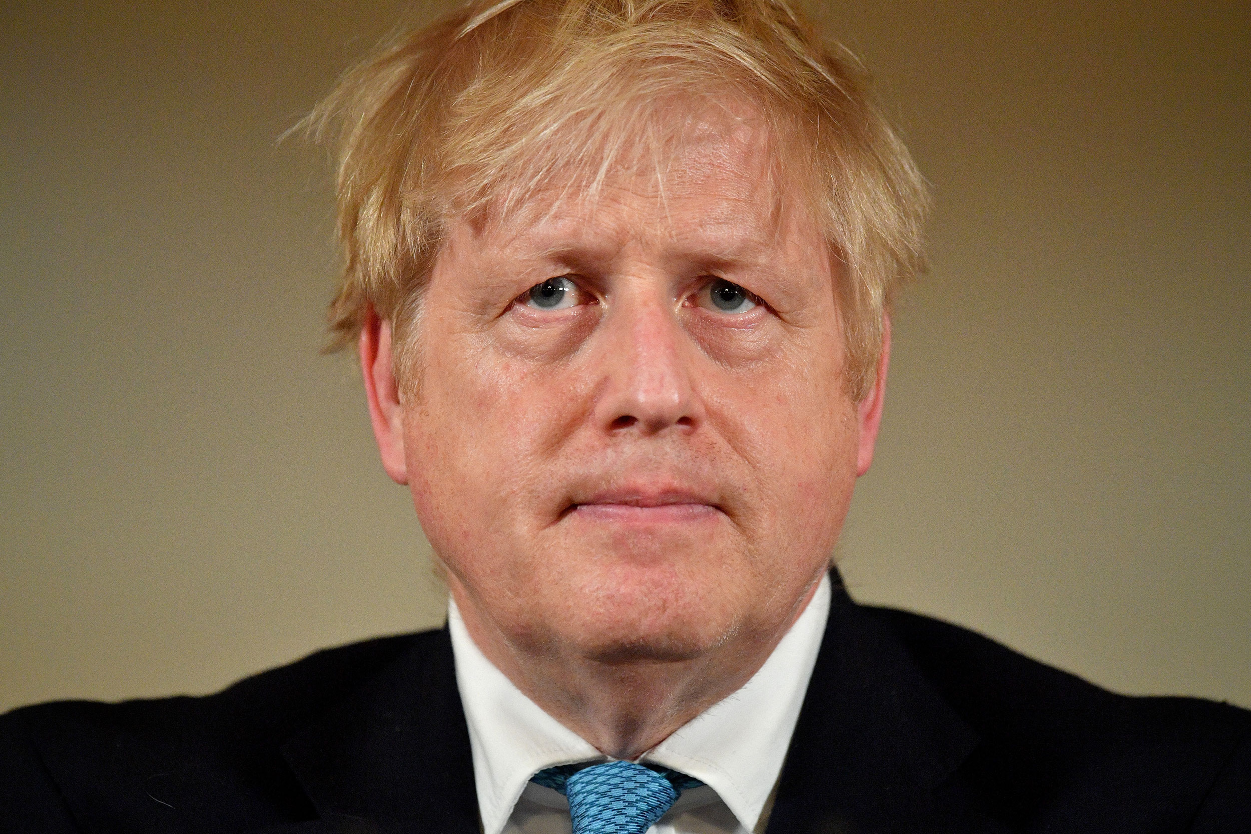British Prime Minister Boris Johnson attends a coronavirus news conference inside number 10 Downing Street on March 19 in London.