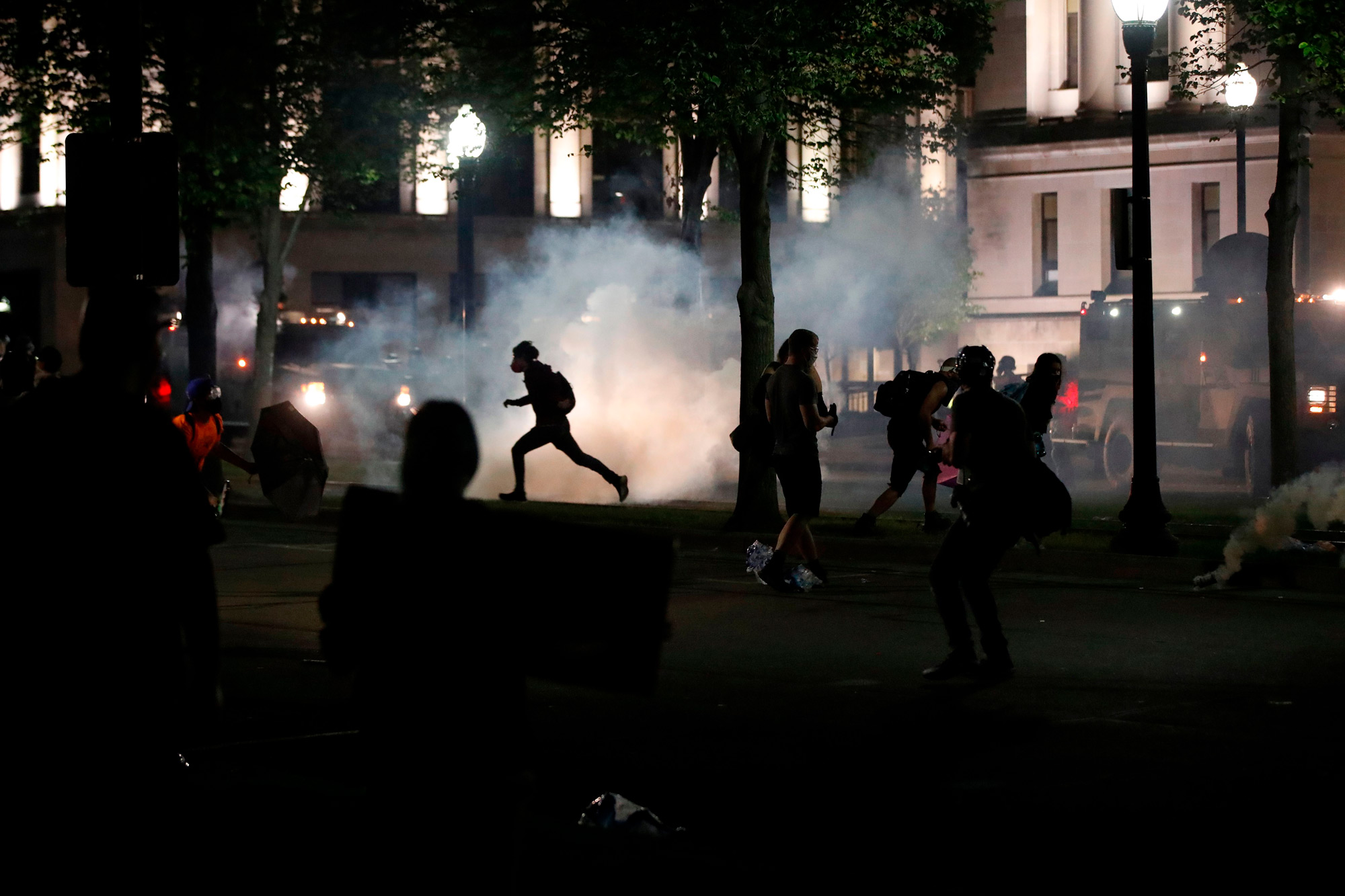 Protesters clash with Kenosha County Sherriff's officers in front of the County Court House during demonstrations against the shooting of Jacob Blake in Kenosha, Wisconsin on August 24.