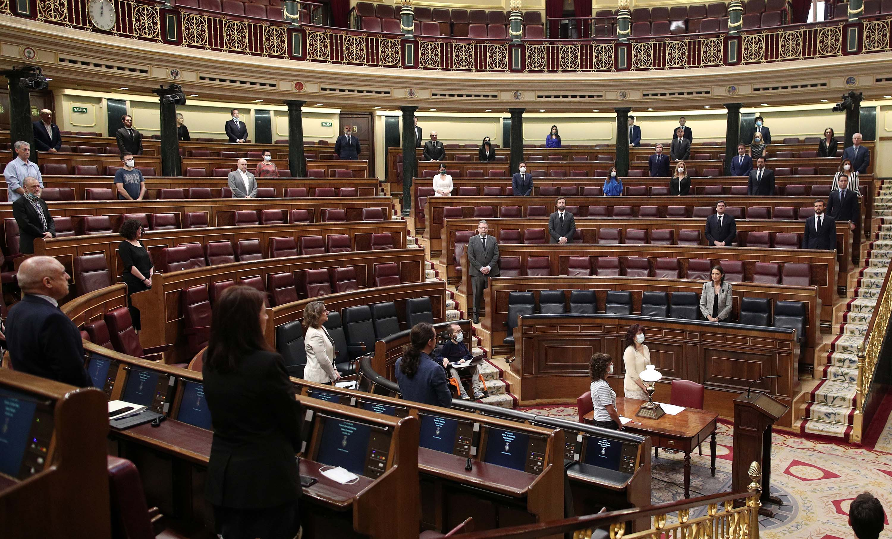 A minute of silence is held to honor coronavirus victims during a plenary session in the Congress of Deputies in Madrid, Spain, on Wednesday, May 27.