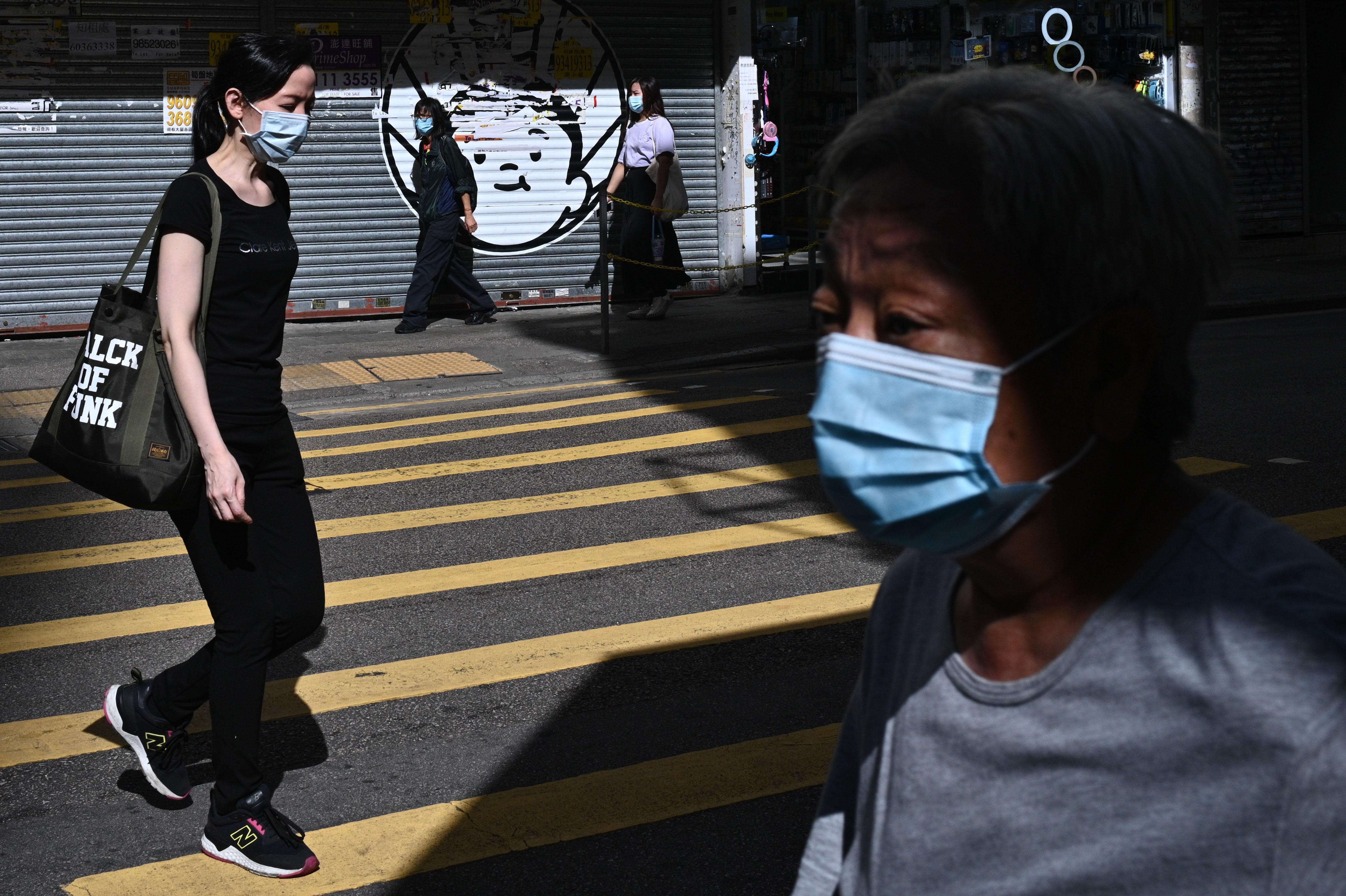 People walk in Hong Kong on July 27.