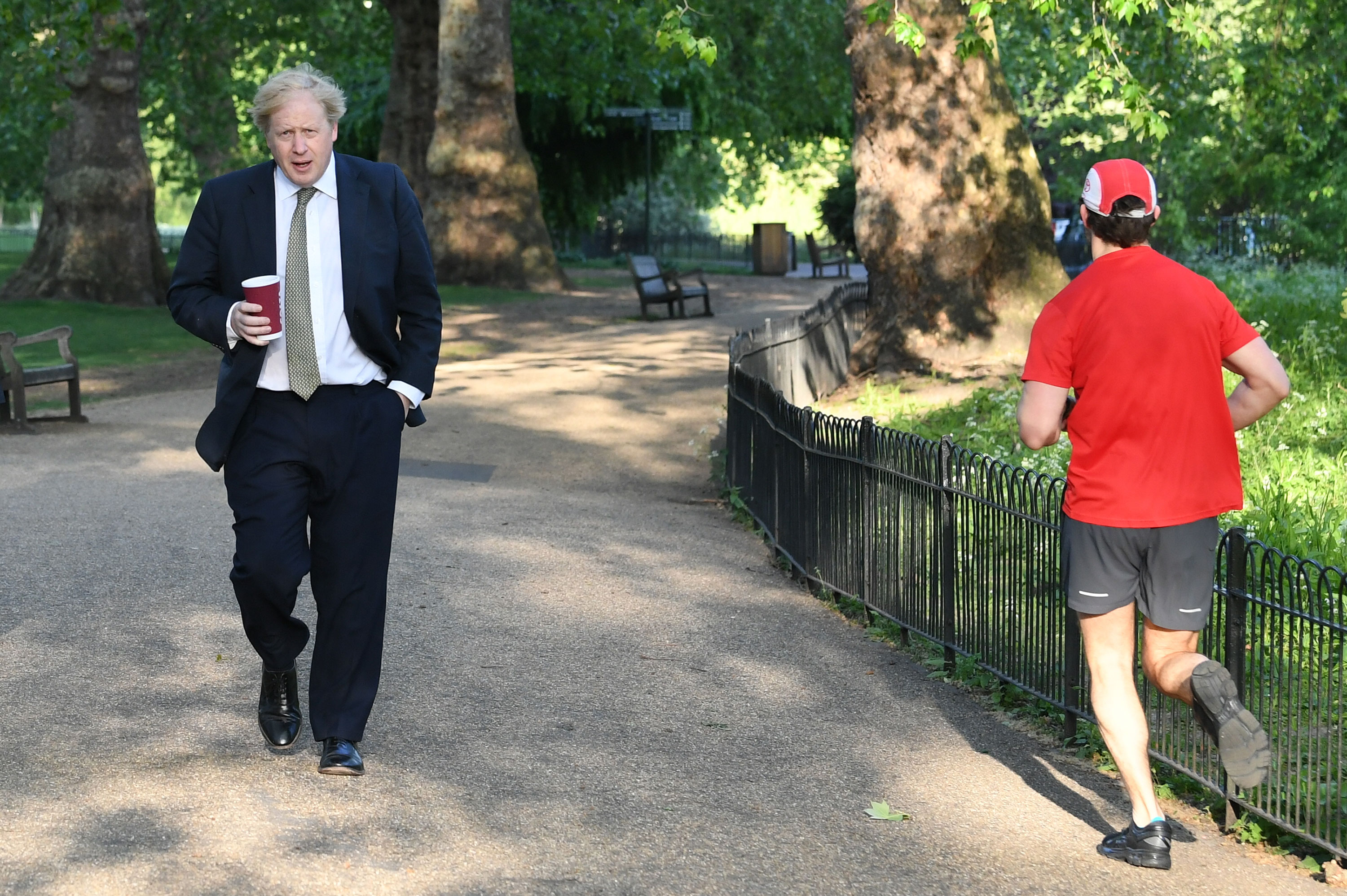 Prime Minister Boris Johnson takes a morning walk in St. James's Park in London before returning to Downing Street on May 6.