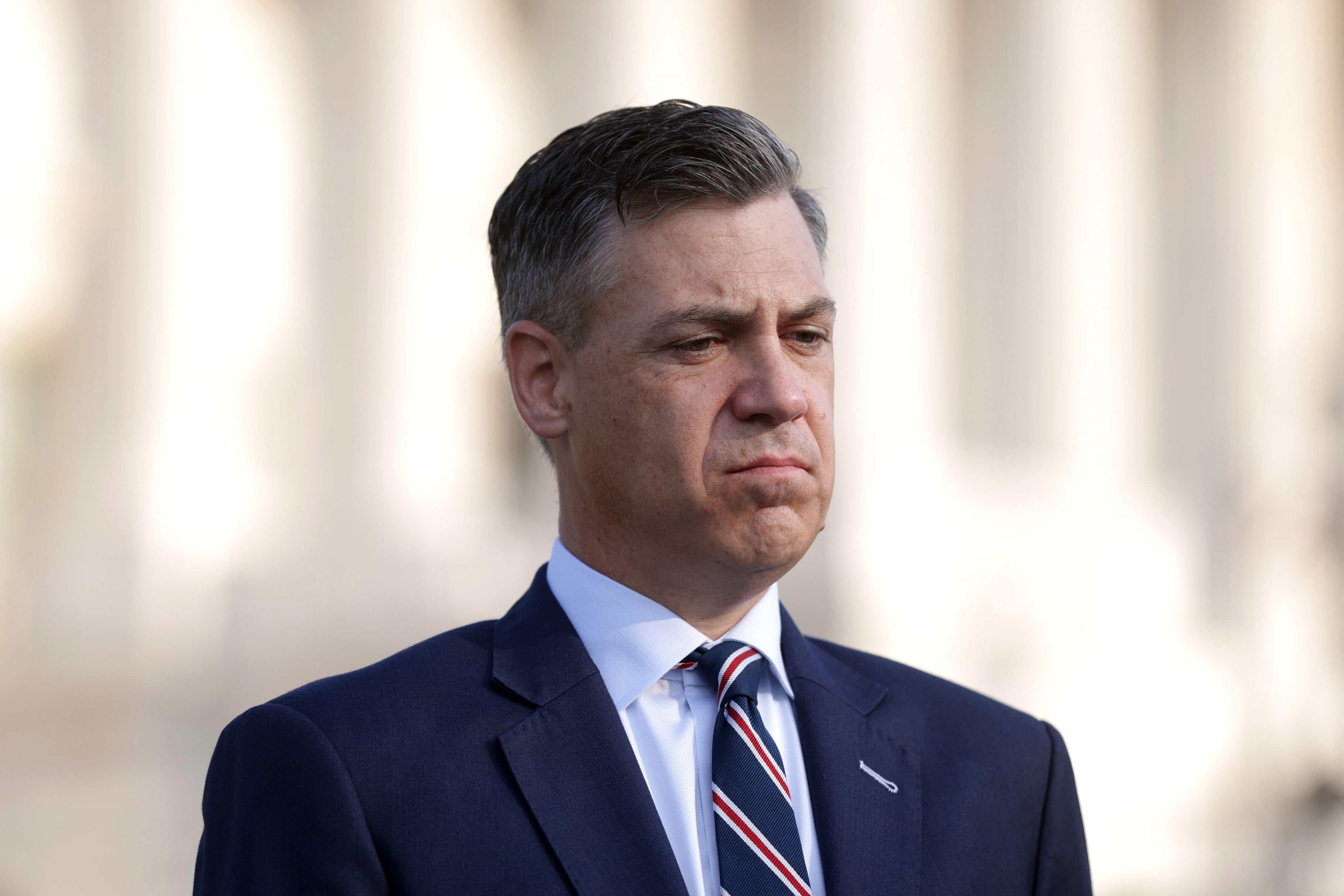 Rep. Jim Banks listens during a news conference in front of the U.S. Capitol on Tuesday, July 27.