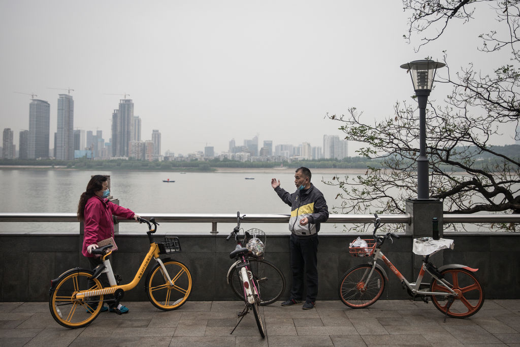 Two people talk near the Yangtze River in Wuhan, China, on April 21.