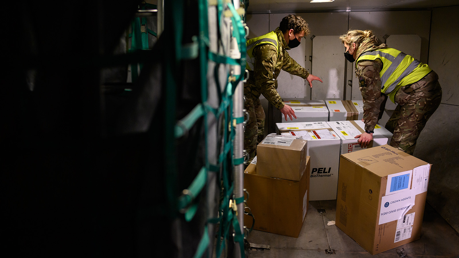 RAF personnel load a batch of the Covid-19 vaccine onto a Voyager aircraft bound for the Falkland Islands at RAF Brize Norton on February 01, 2021 in Brize Norton, England.