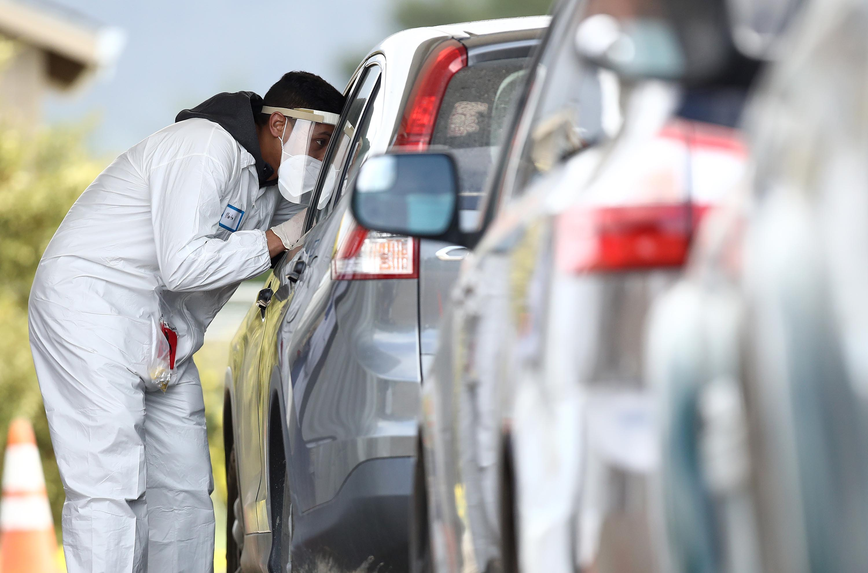 A medical professional administers a coronavirus test at a drive thru testing location in Bolinas, California, on April 20.