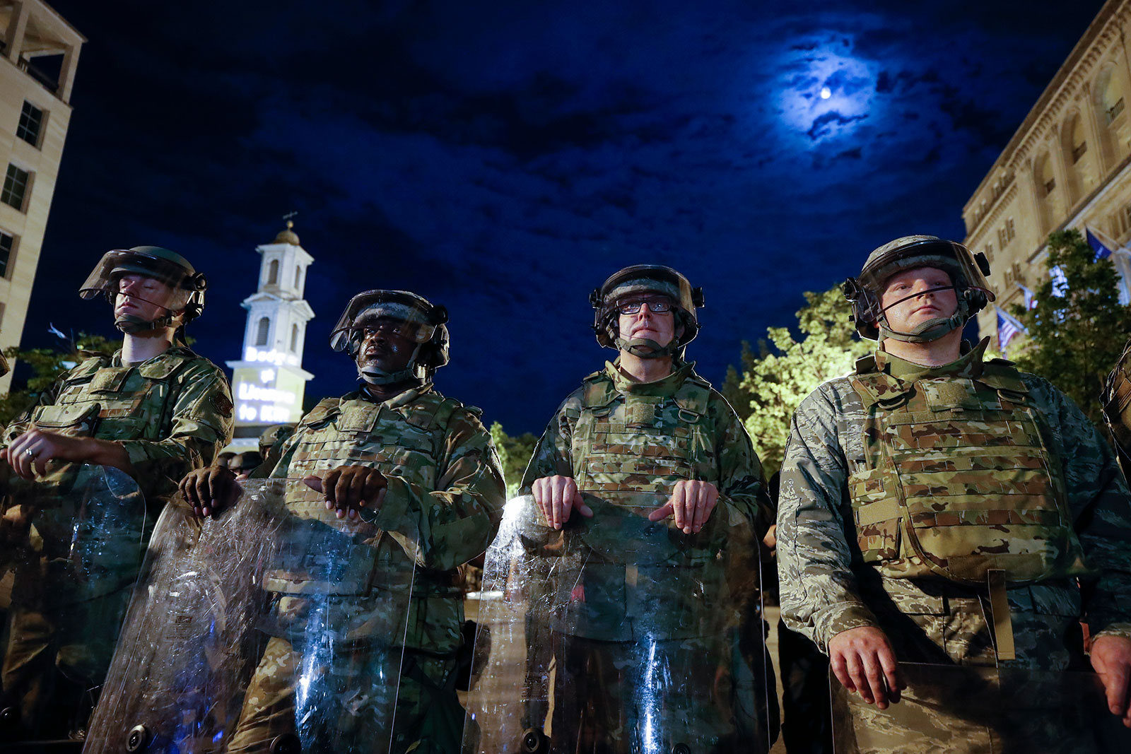 Utah National Guard soldiers stand guard as demonstrators gather to protest near the White House on Thursday, June 4.
