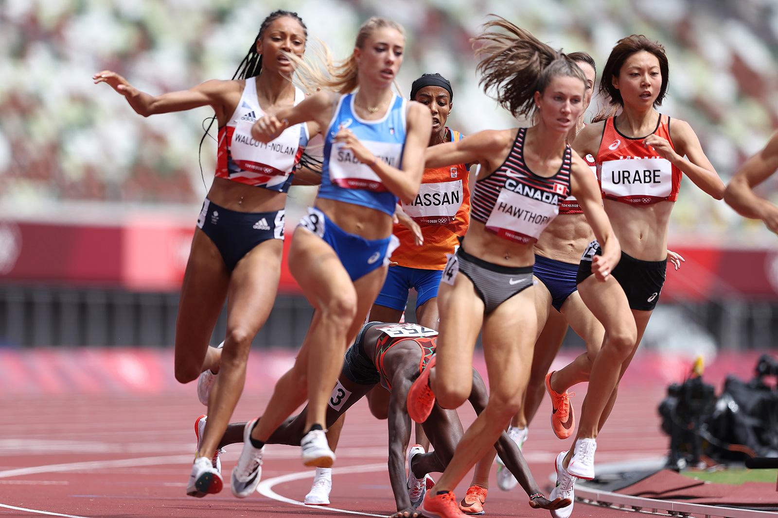 Kenyan runner Edinah Jebitok falls, tripping Sifan Hassan during a 1500 meter heat on Monday.