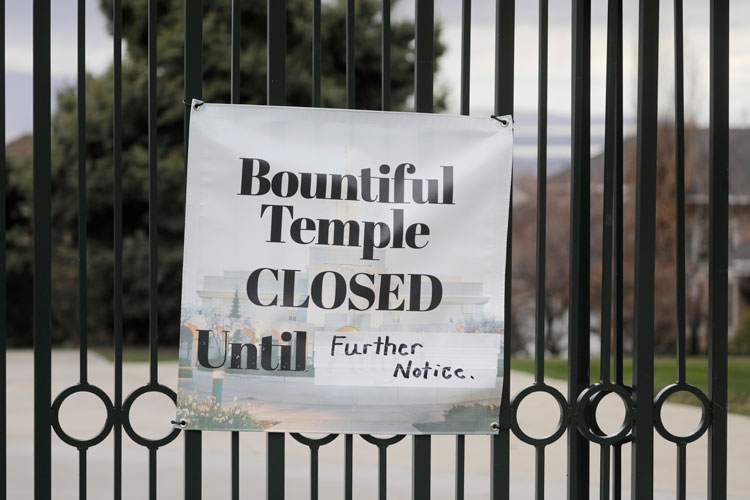 A closed sign is shown at The Church of Jesus Christ of Latter-day Saints Bountiful Temple Tuesday, March 24, in Bountiful, Utah.