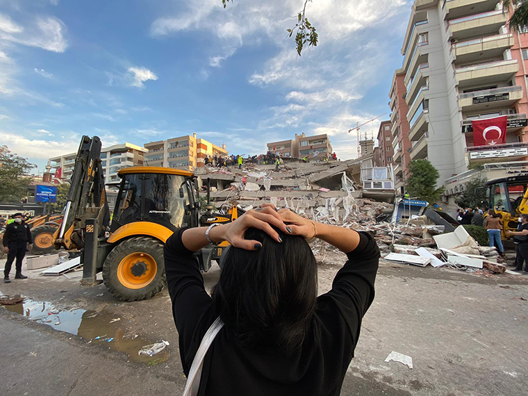 A woman reacts as search and rescue work continues in Izmir, Turkey on October 30, 2020.
