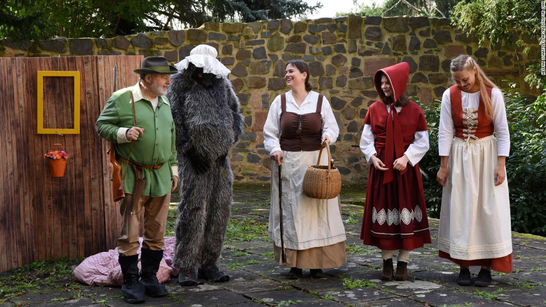 """Characters perform """"Little Red Riding Hood"""" at the monestery garden."""