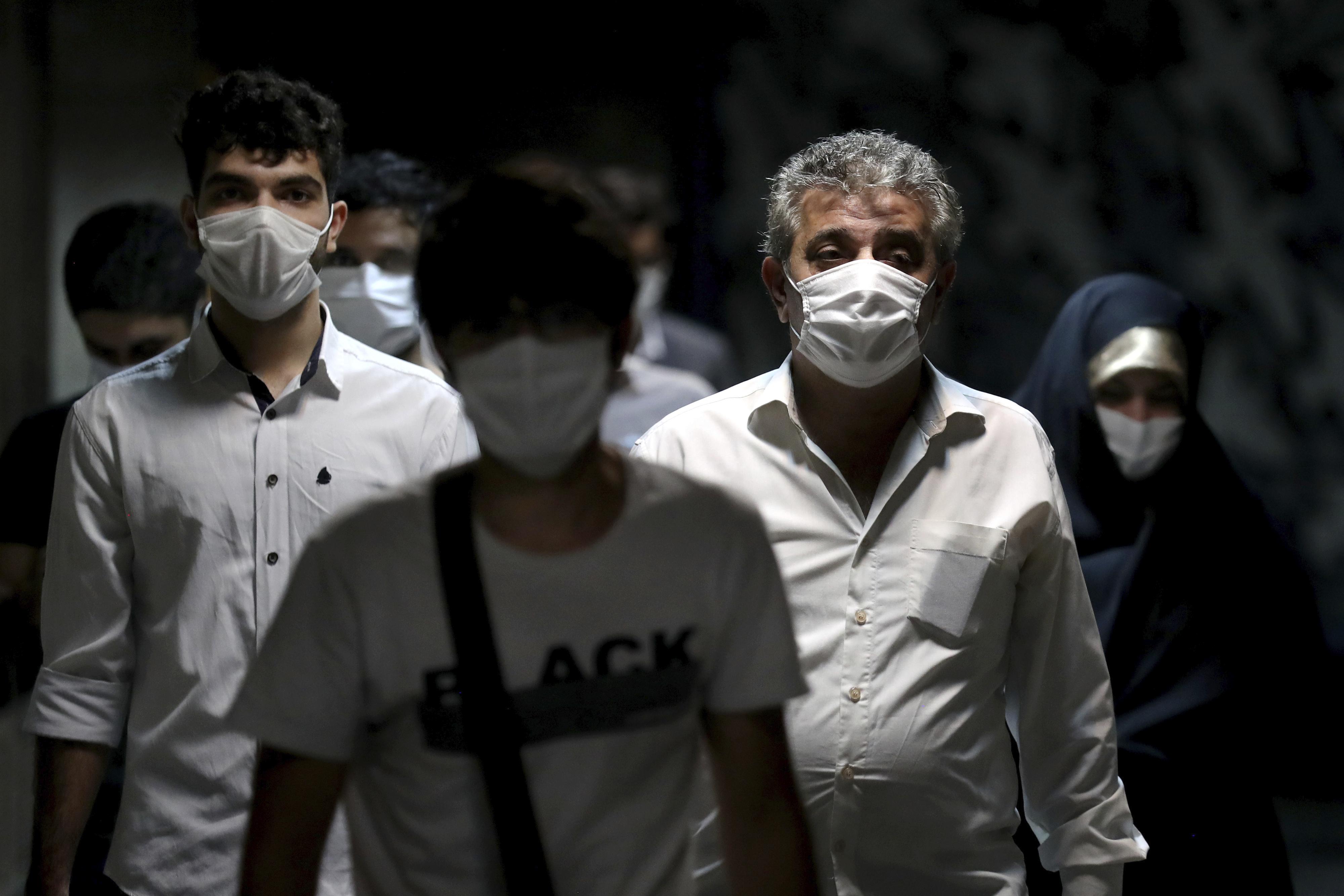 People walk in a metro station in Tehran, Iran, on July 8.