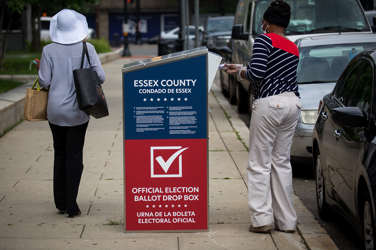 A voter uses a mail-in ballot drop off box location in Newark, New Jersey on July 7.