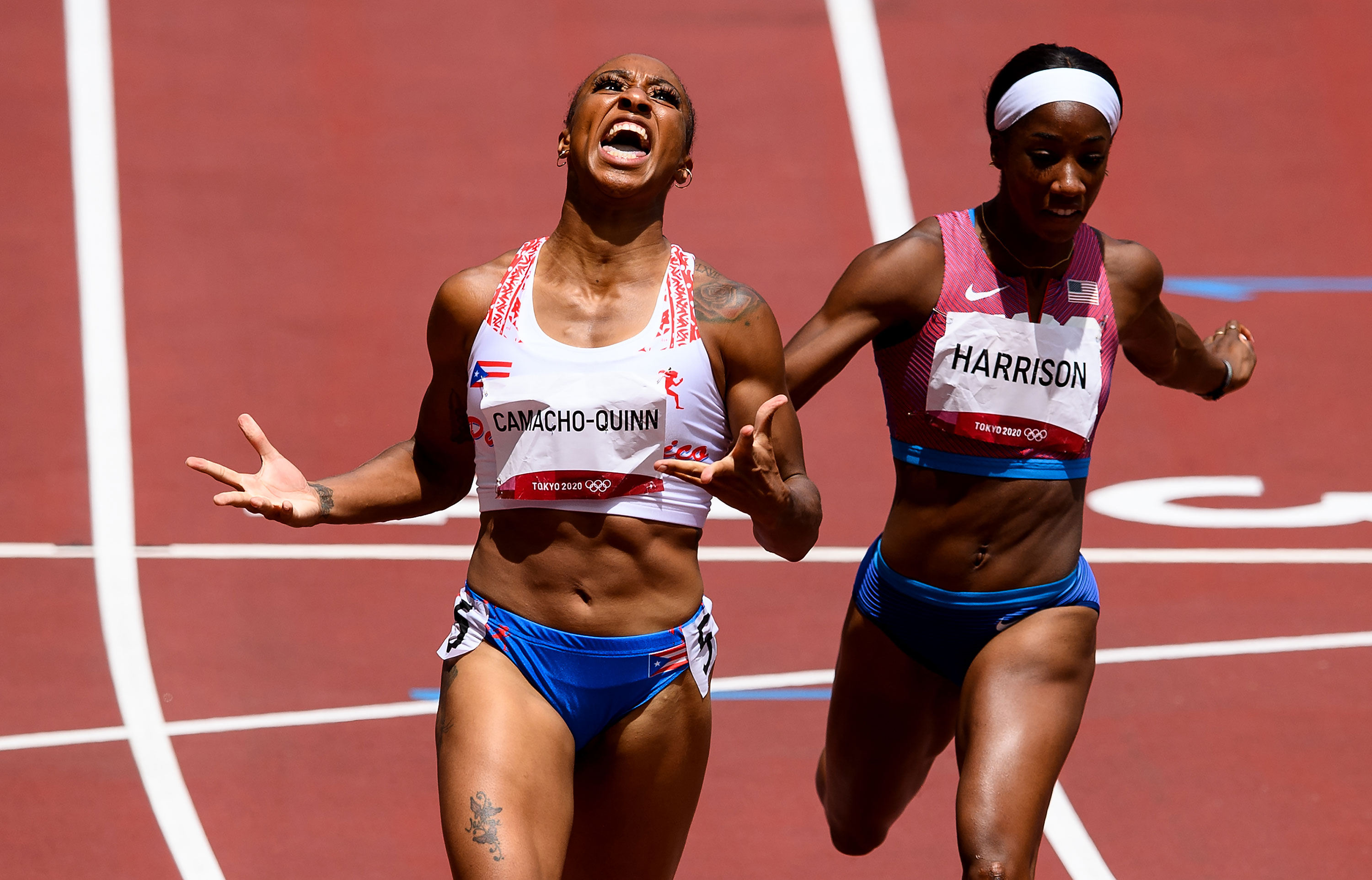 Jasmine Camacho-Quinn of Puerto Rico celebrates as she finishes first in the 100-meter hurdles final on August 2.