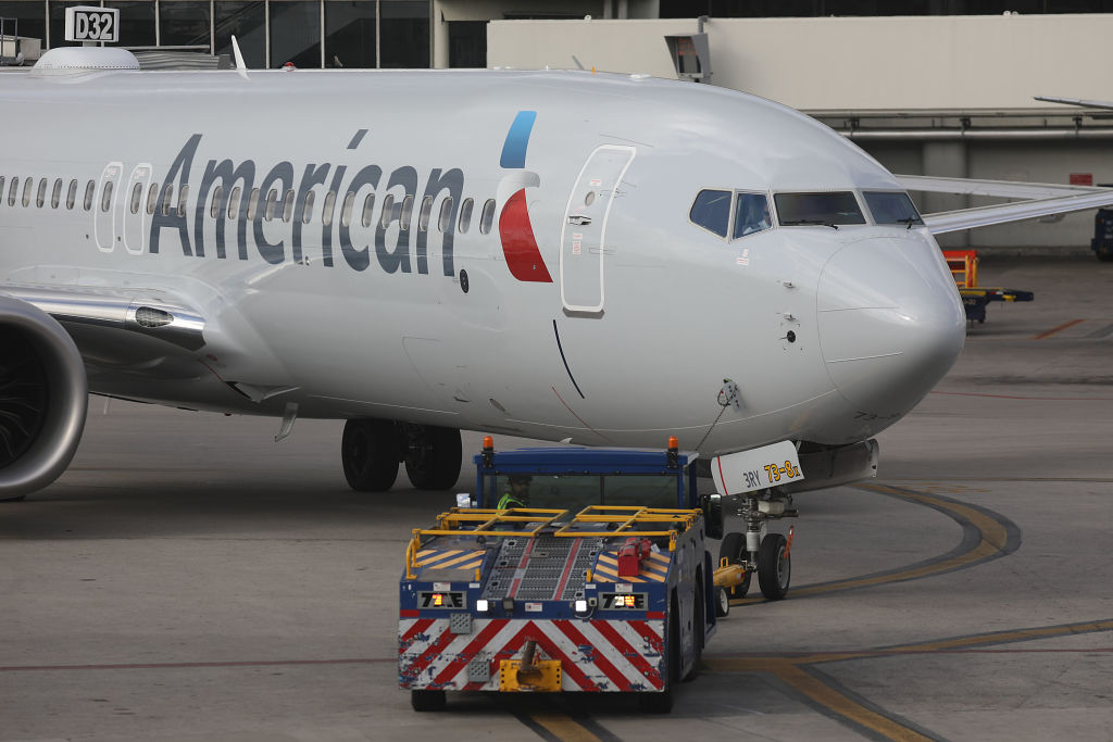 An American Airlines Boeing 737 Max 8 is towed to its gate at the Miami International Airport on Wednesday.